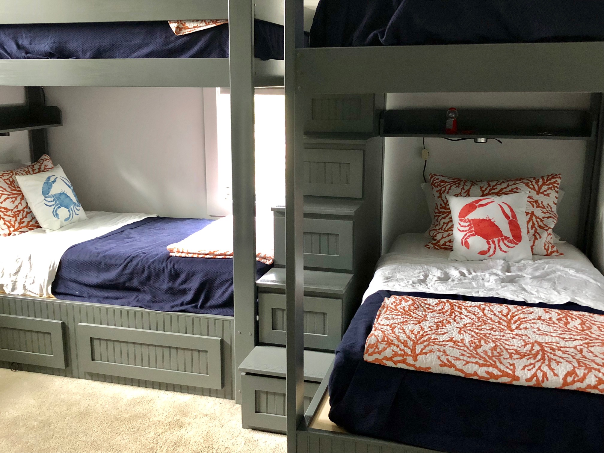 Upstairs is a bunk room with six twin beds.