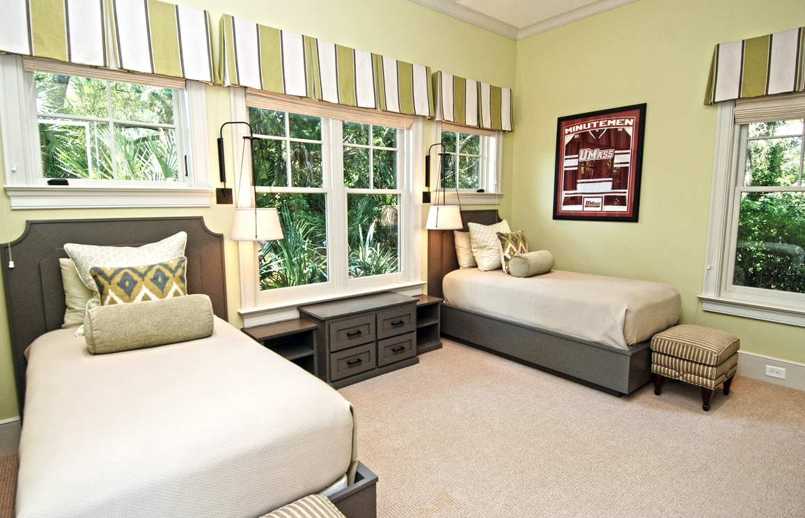 The 3rd bedroom has two twin beds and an attached full bathroom.