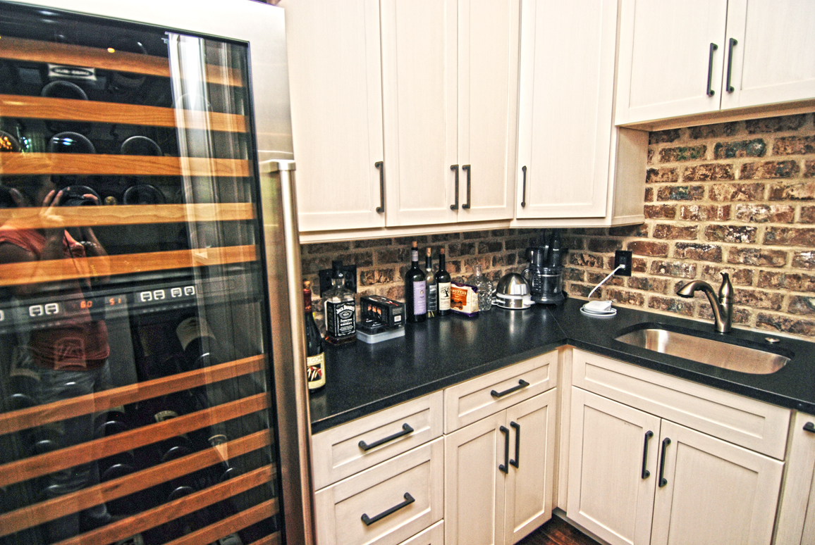 Butlers pantry off the kitchen features a huge wine fridge.