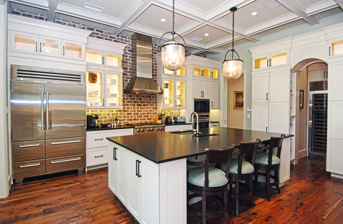The gourmet kitchen has professional grade appliances, a pantry, & wet bar.
