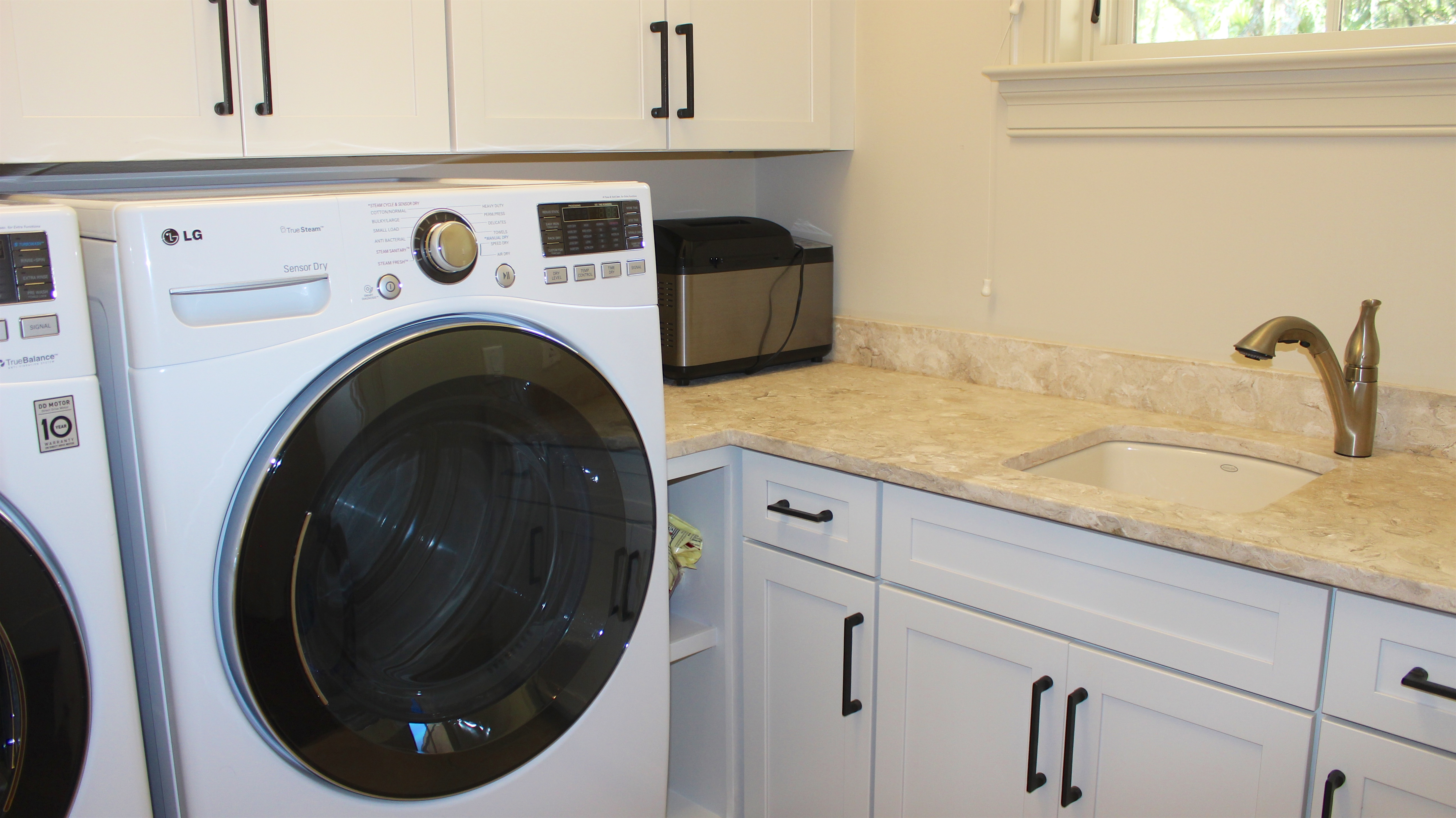 The laundry room has granite counters and premium LG front load appliances.