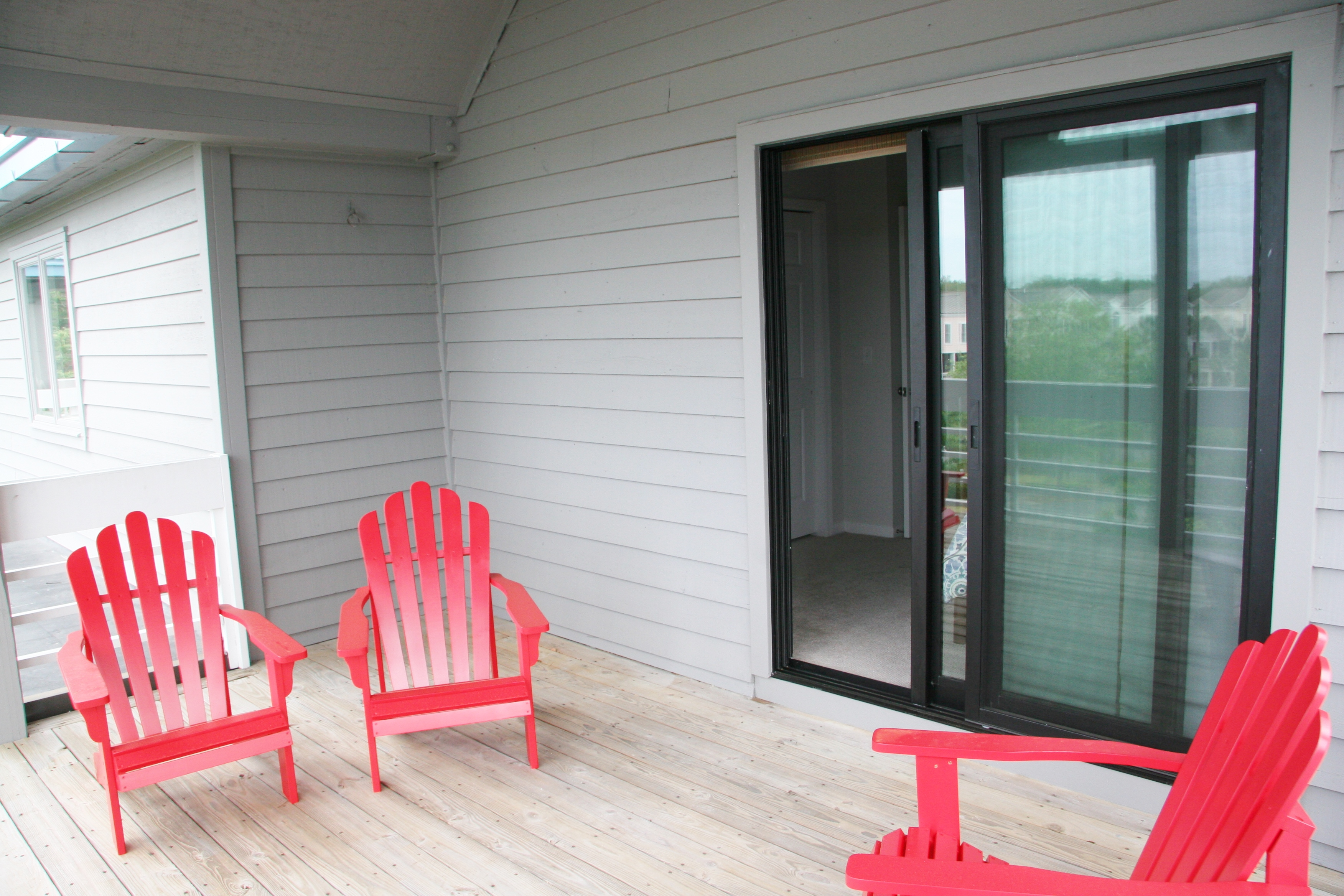 Relax in the new chairs on the guest bedroom deck.