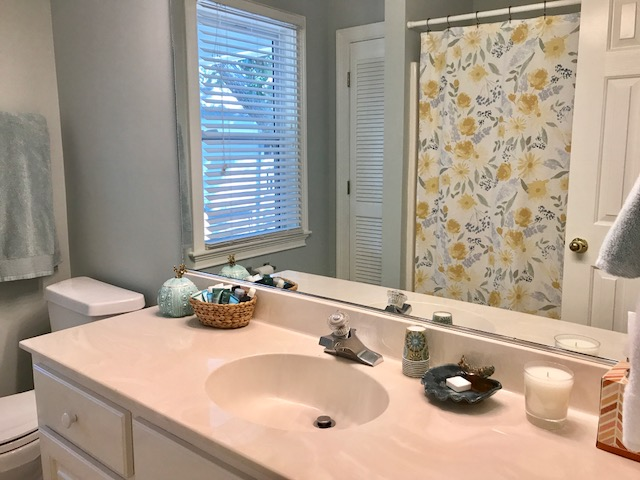 The second bathroom is located in the hallway between the second and third bedrooms and has a shower/tub combo.