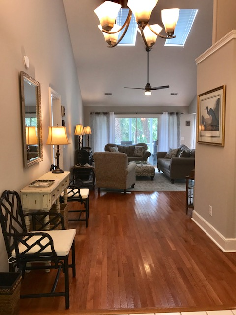 Beautiful hardwood floors and a foyer table welcome you to this home. The table lamp is timed to go on and off in the evening.