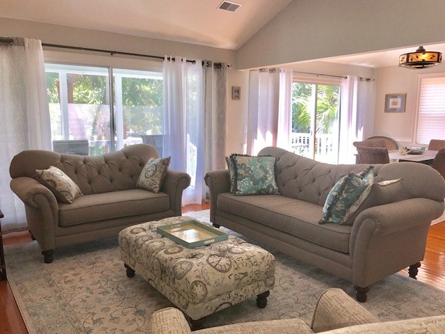 There is plenty of conversational seating in the living room. There are skylights with shades in the living room and the tool to open the shades is stored in the master bedroom closet.