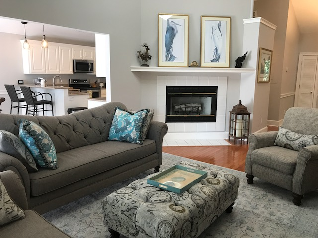 This stylish living room is open to the kitchen area. The fireplace is not for guest use.