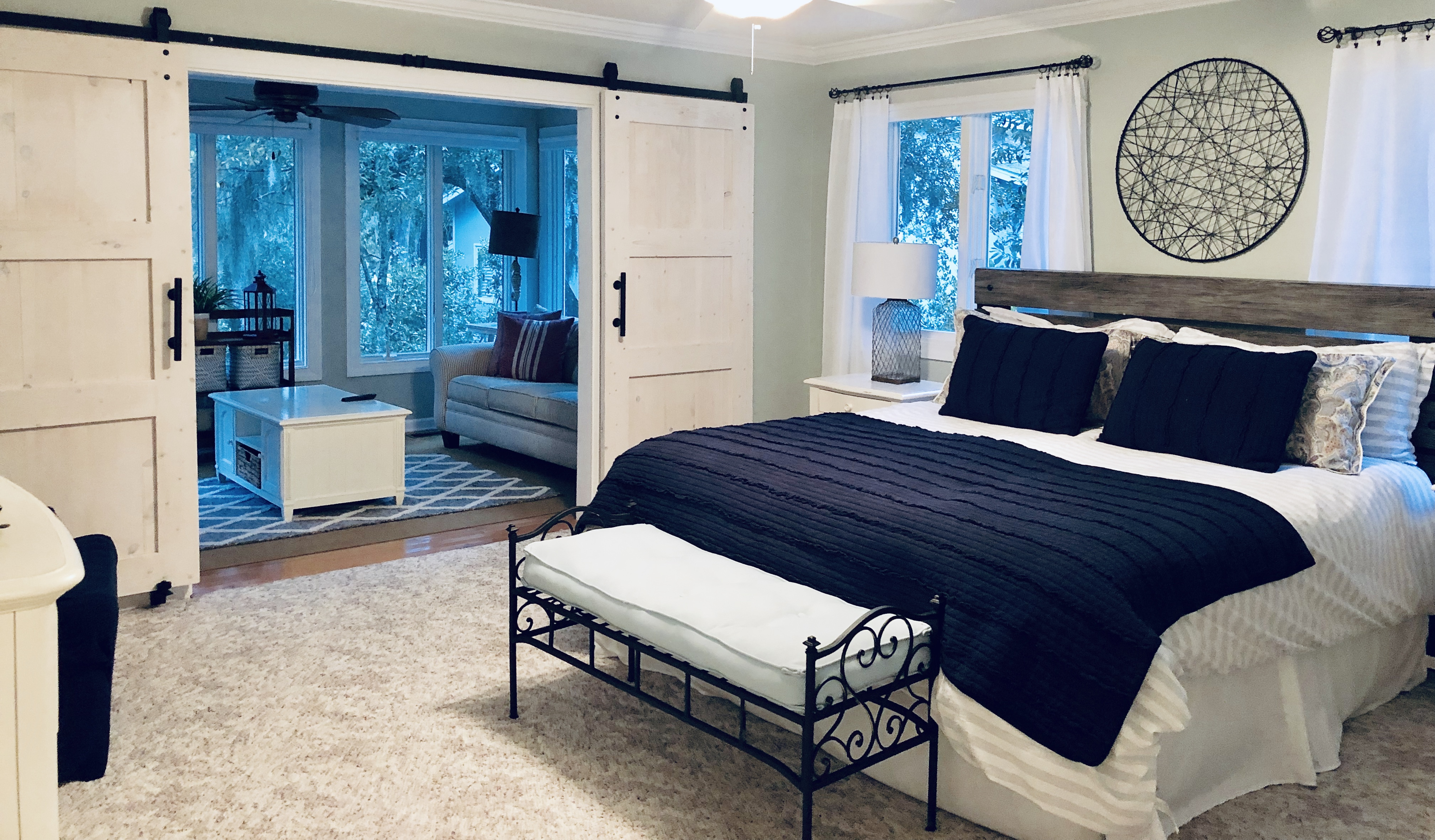 Barn Doors close off sun room from the master bedroom - with a pull out bed with new foam mattress for the kiddos!