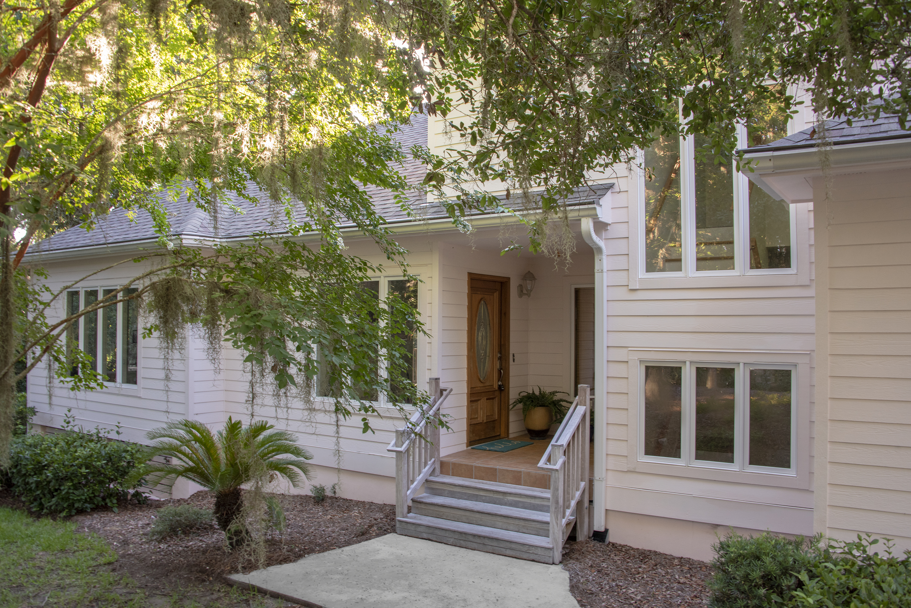 Beautifully nestled on a private, elevated lot