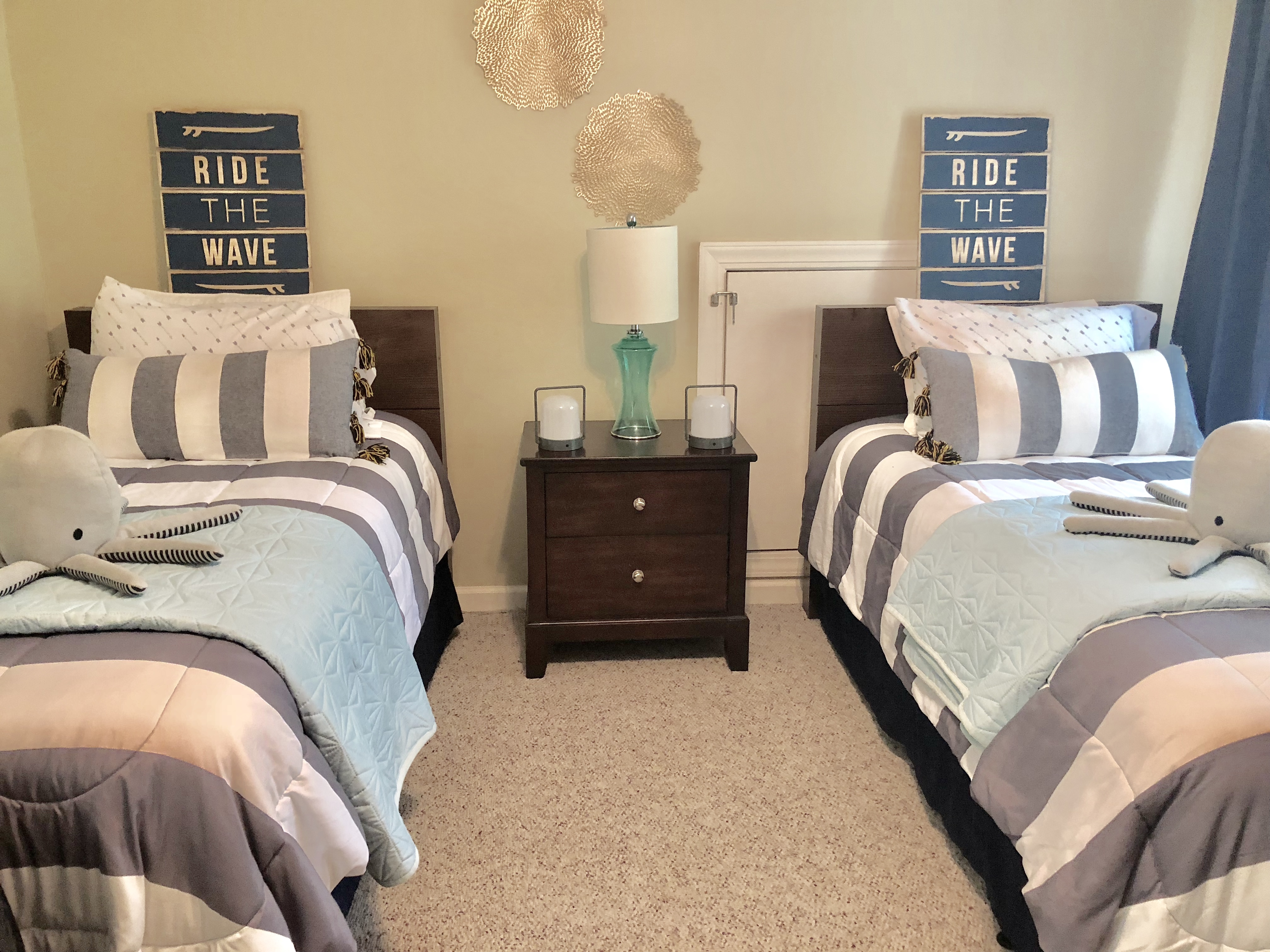 Twin beds with Black Out Curtains