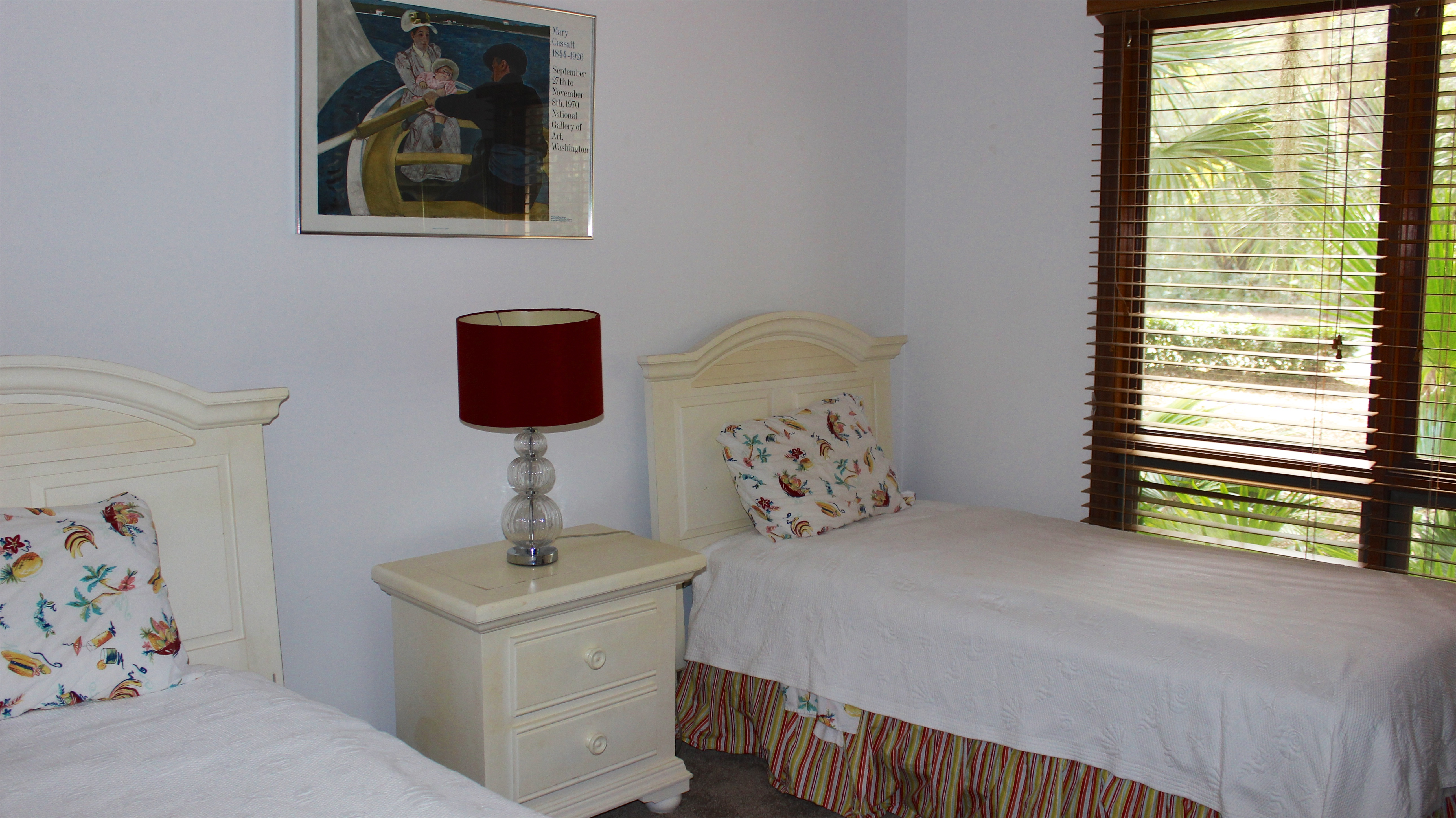 Just beyond is the 1st bedroom. It has two twin beds.