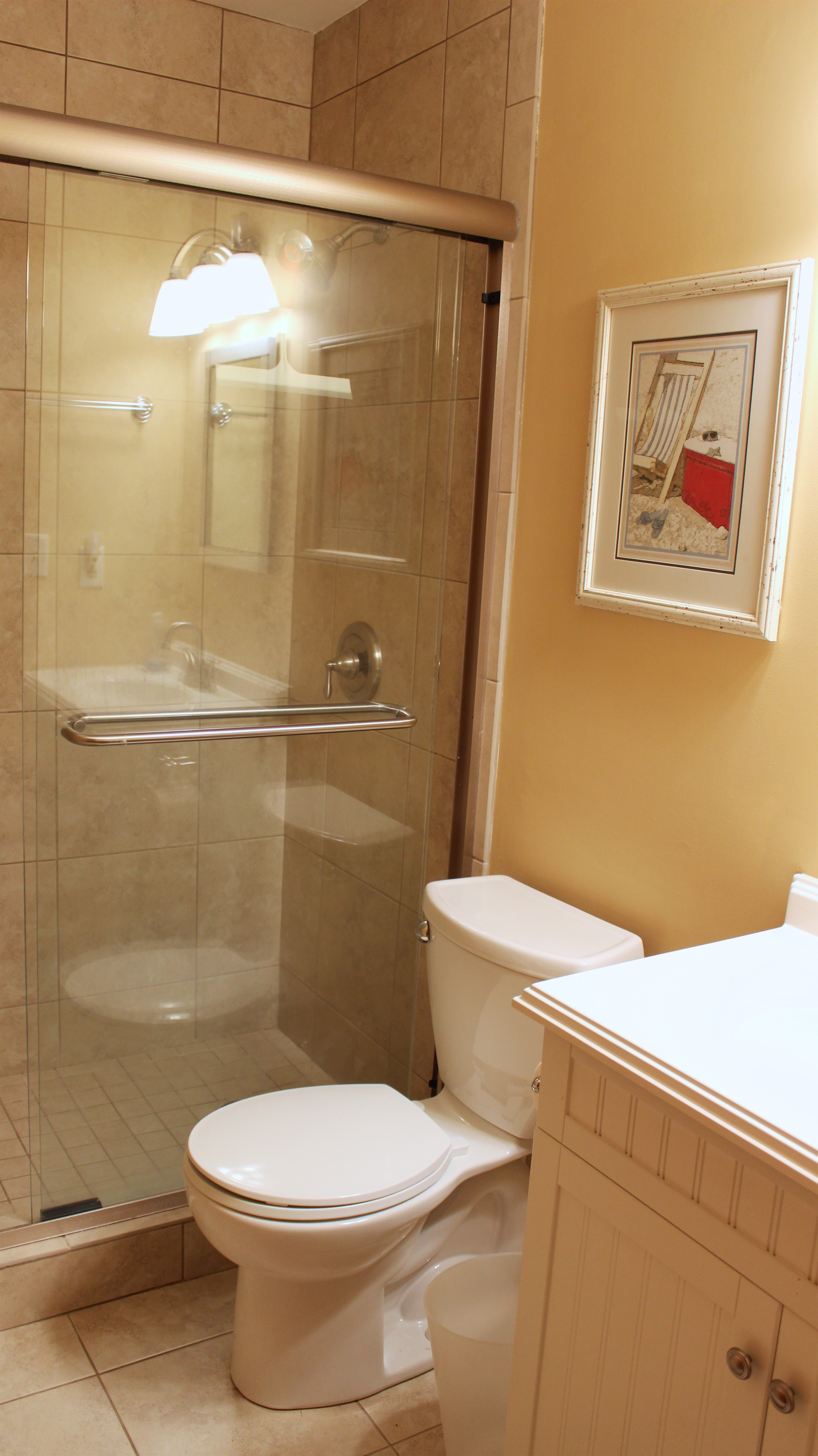 Off the hall leading to the bedrooms is a full bath with a tiled shower.