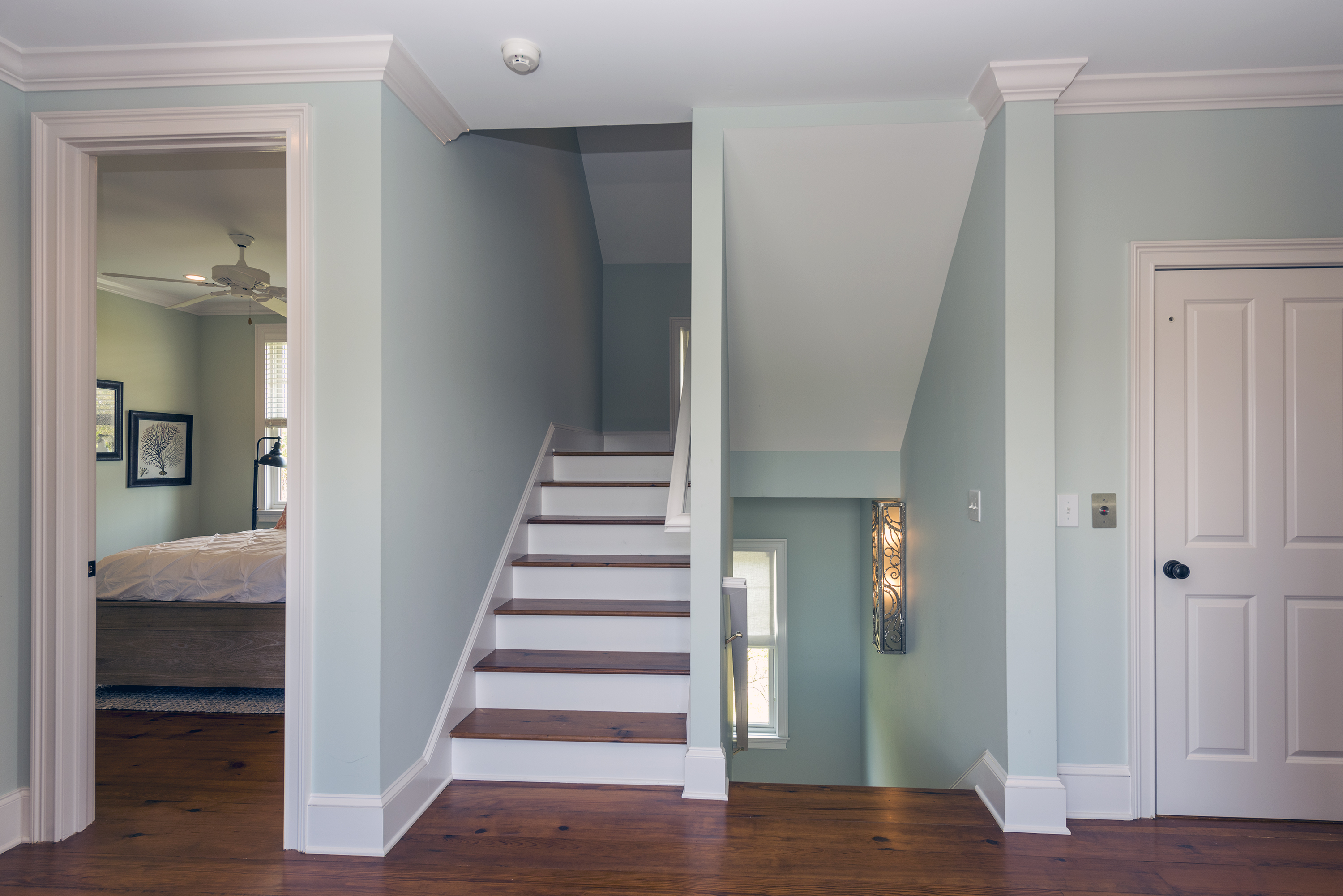 Ascend the stairs to the second floor bedroom area.