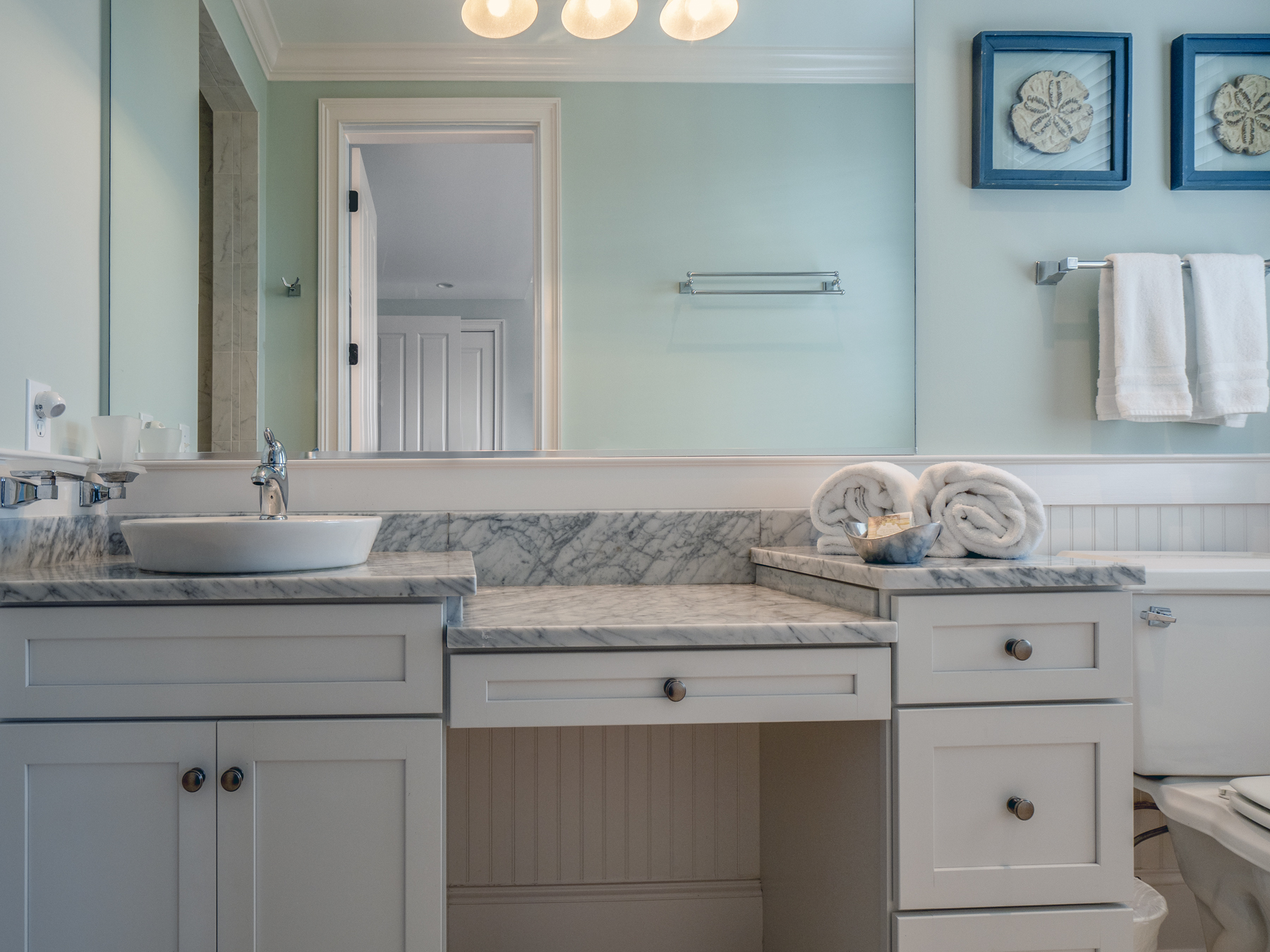 Beautiful guest bath with marble vanity