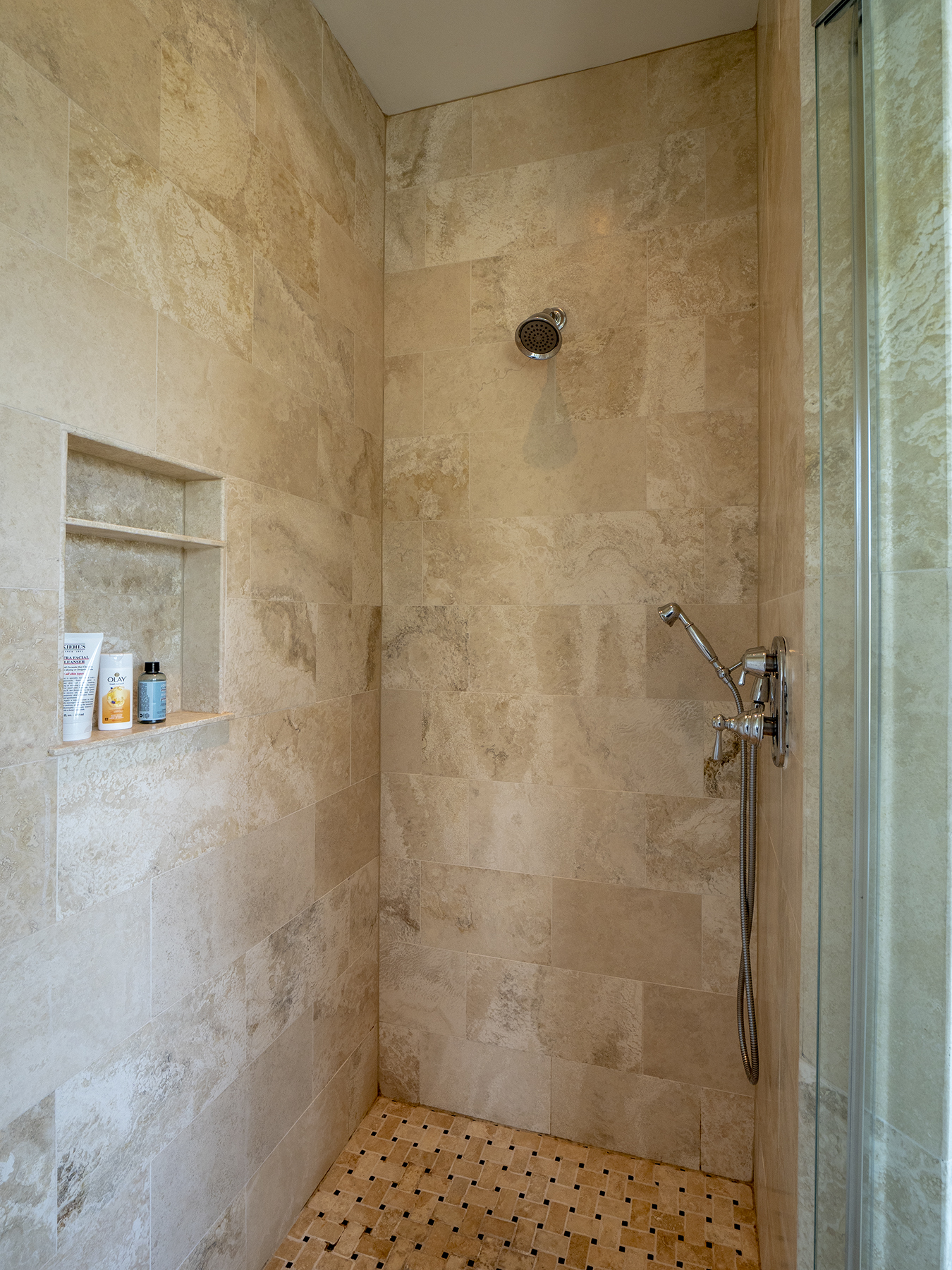 Beautiful tiles shower with hand held wand