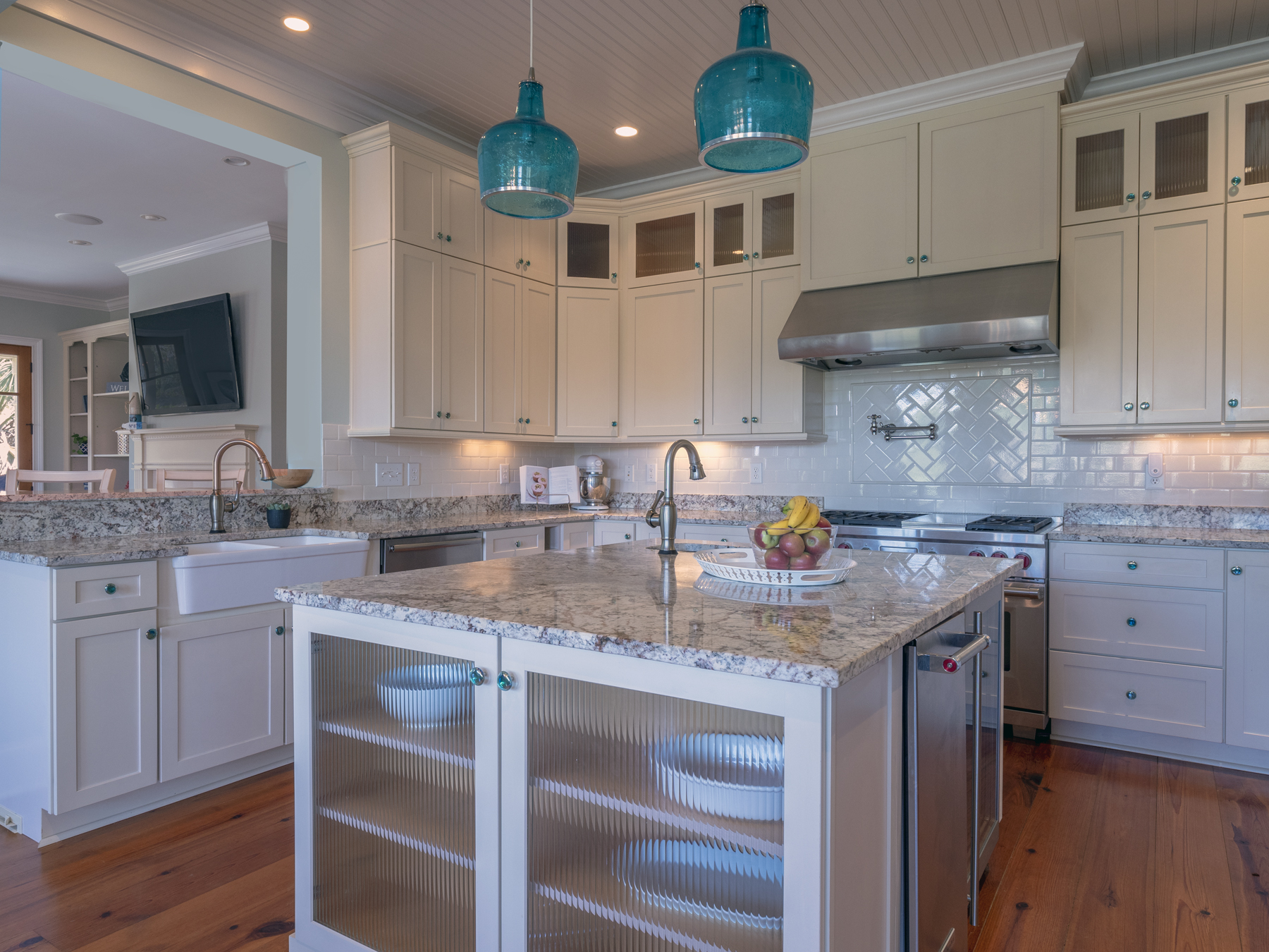 The fully stocked chefs dream kitchen features a gas cook top, range, wine fridge and Sub Zero refrigerator.