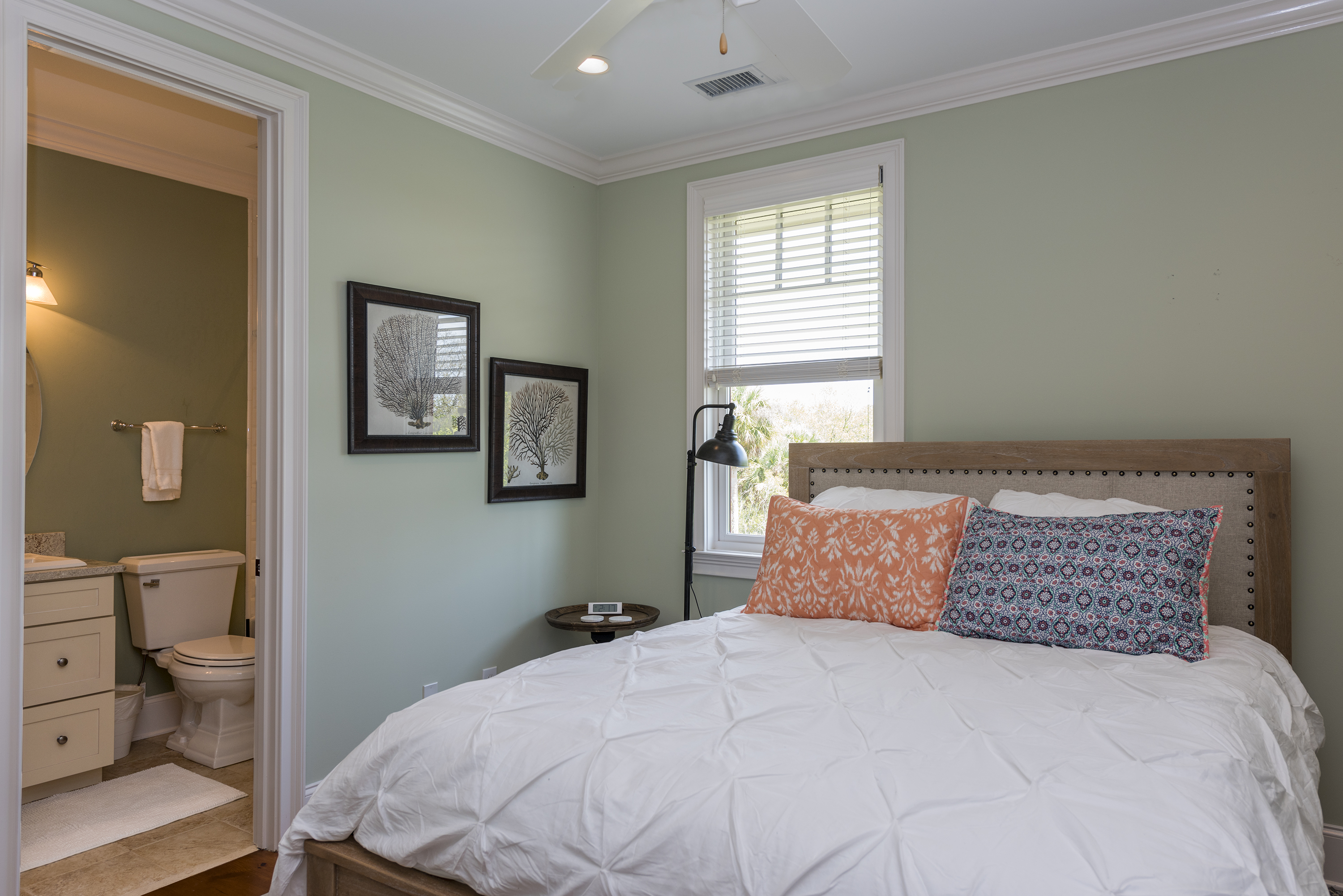 The second guest bedroom with private bath is on the upper level.