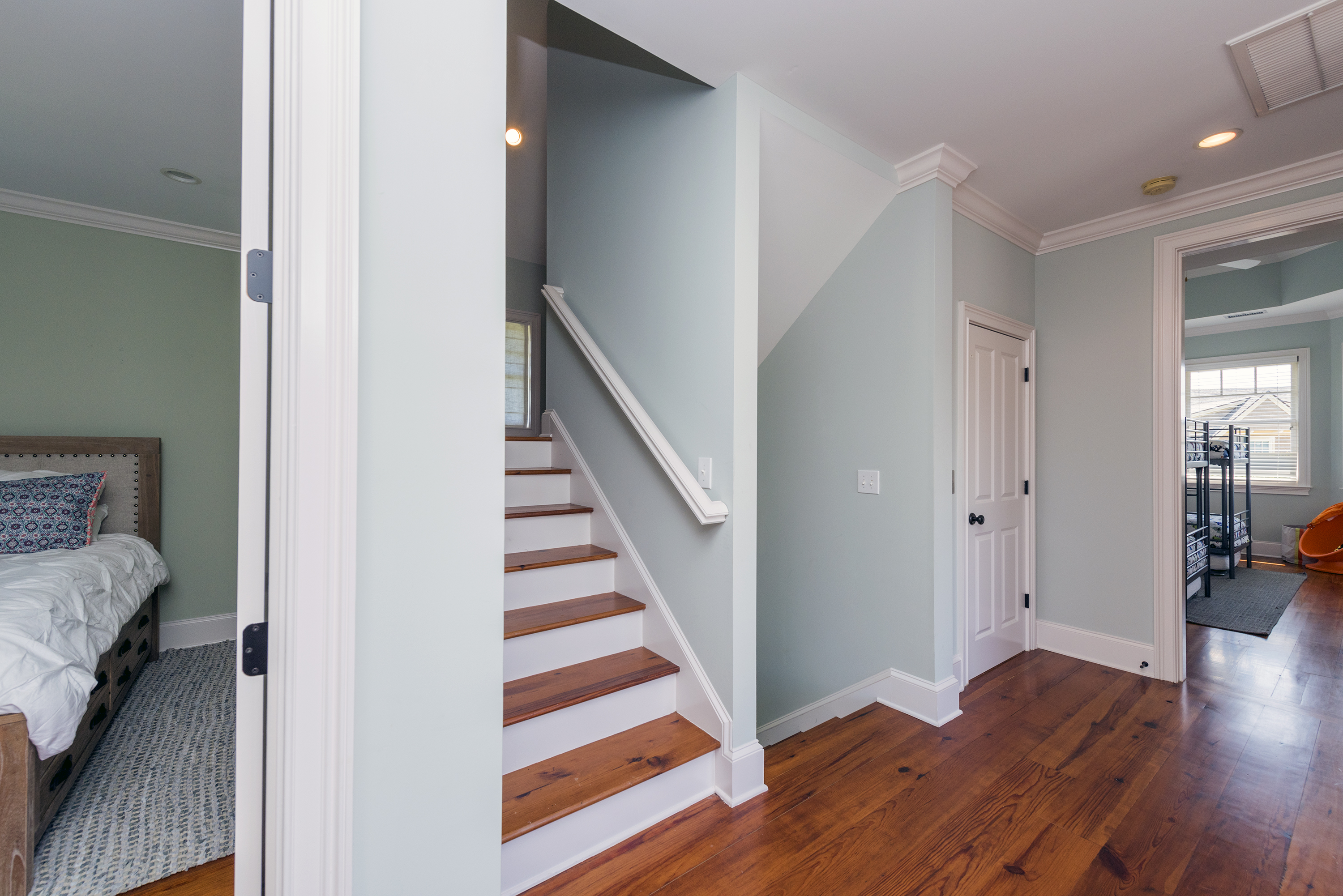 Large hallway on the top floor with steps leading to the storage attic