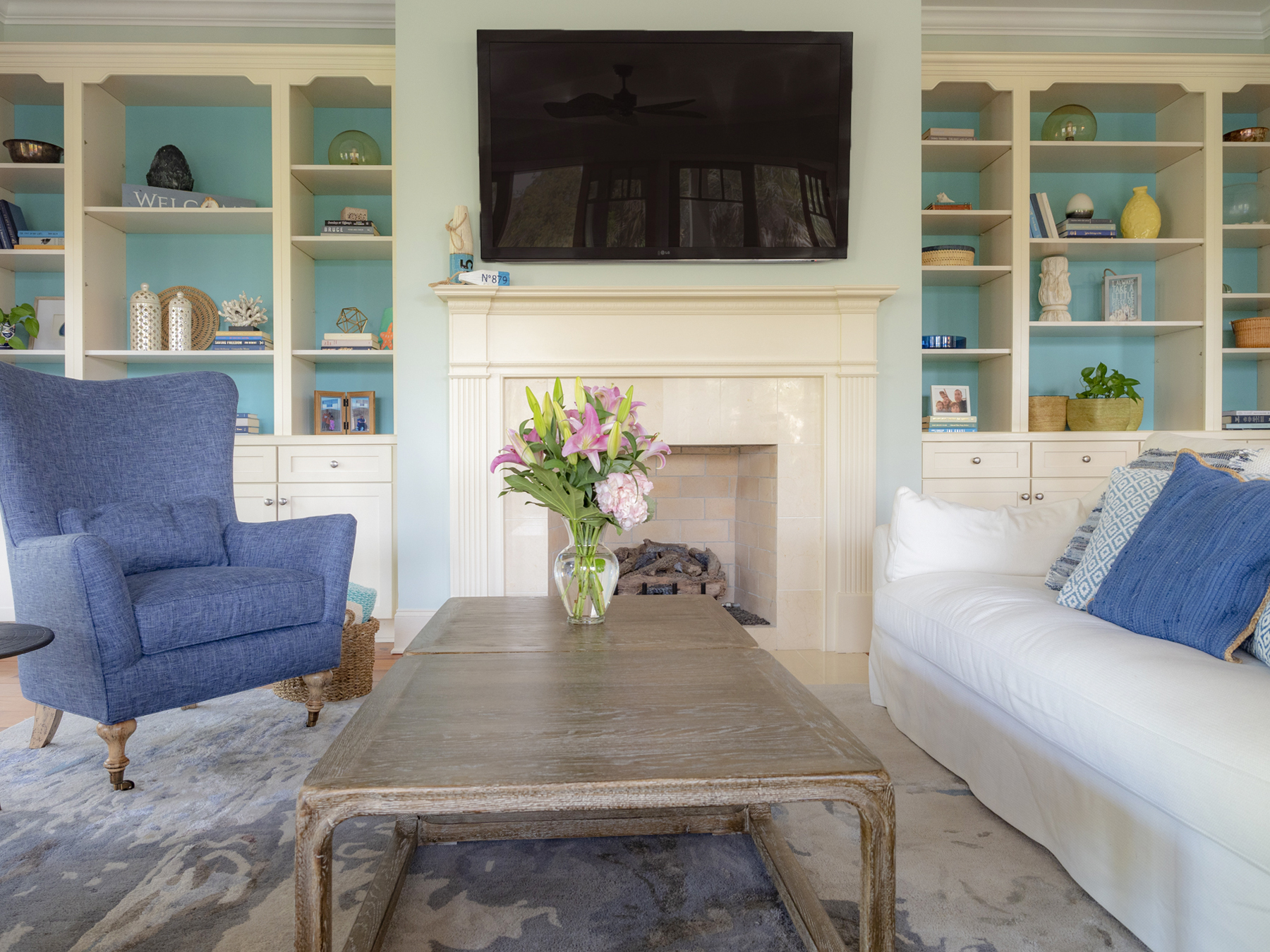 A large HDTV sits above the gas fireplace.