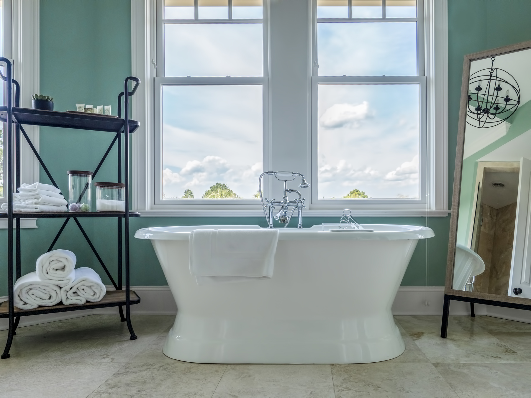 The large master bathroom features a soaking tub with panoramic views, dual granite vanities, and custom tile shower.