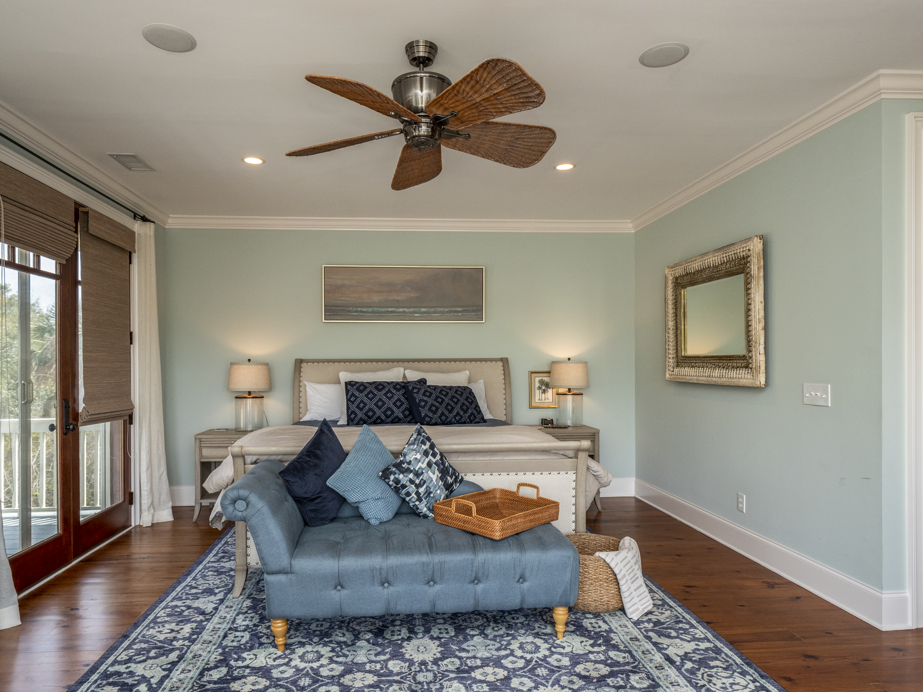 The master suite has a king bed and three sets of french doors, flooding this room with natural light and gorgeous views.