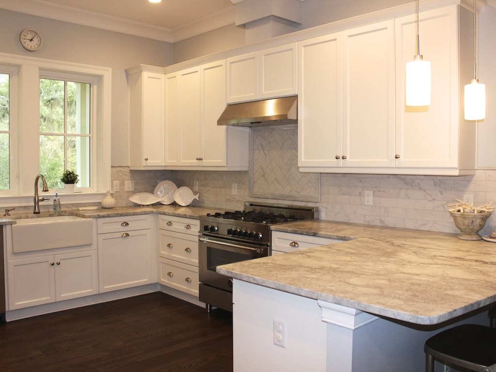 The gourmet kitchen is a chef's delight! Quartzite countertops in soft whites and grays and a farm sink are just two highlights.