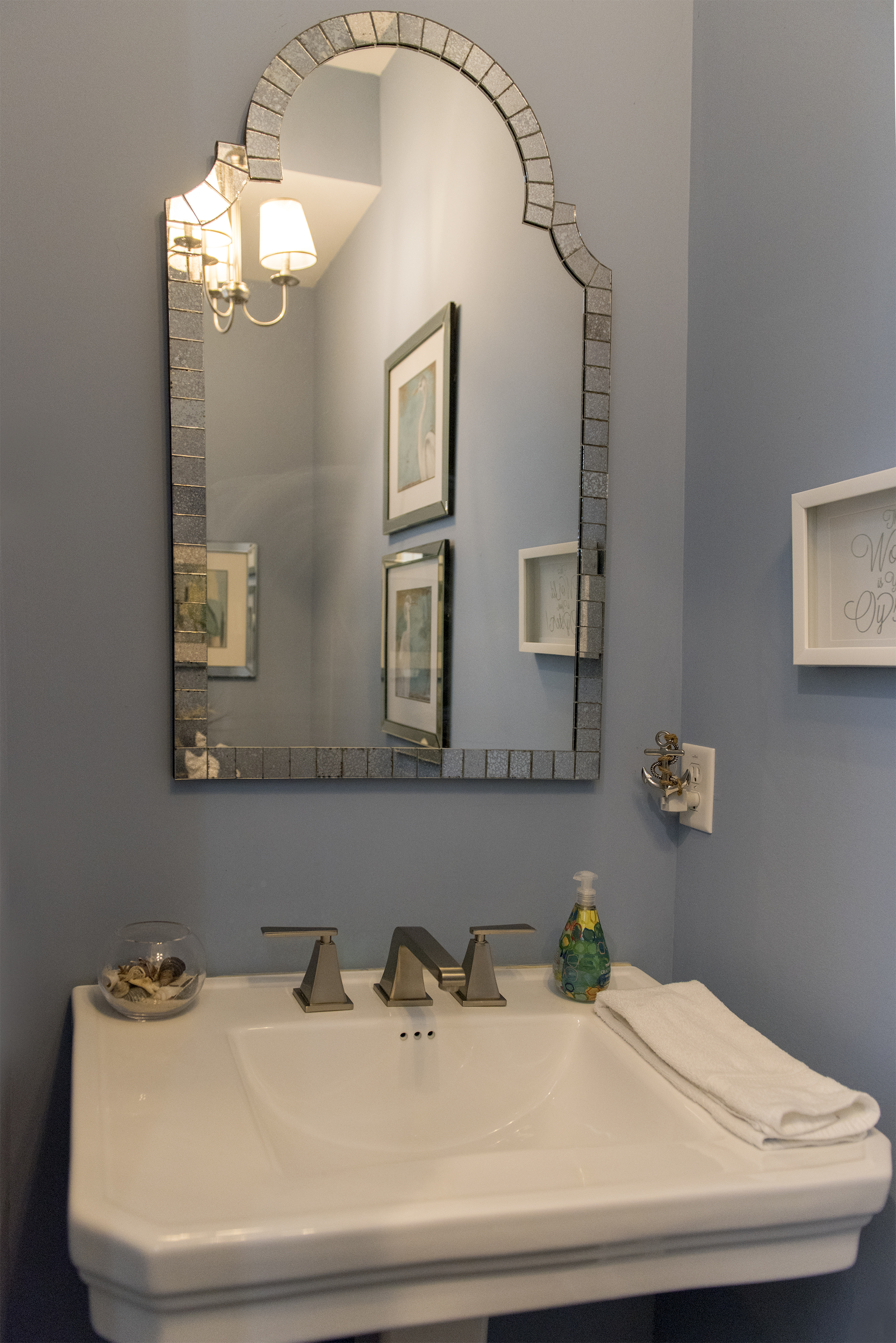 Off the great room is the powder bathroom.