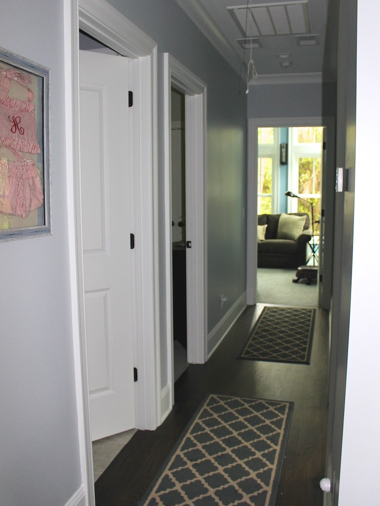 Down the hall are two additional bedrooms, a full bath, and a lounge.