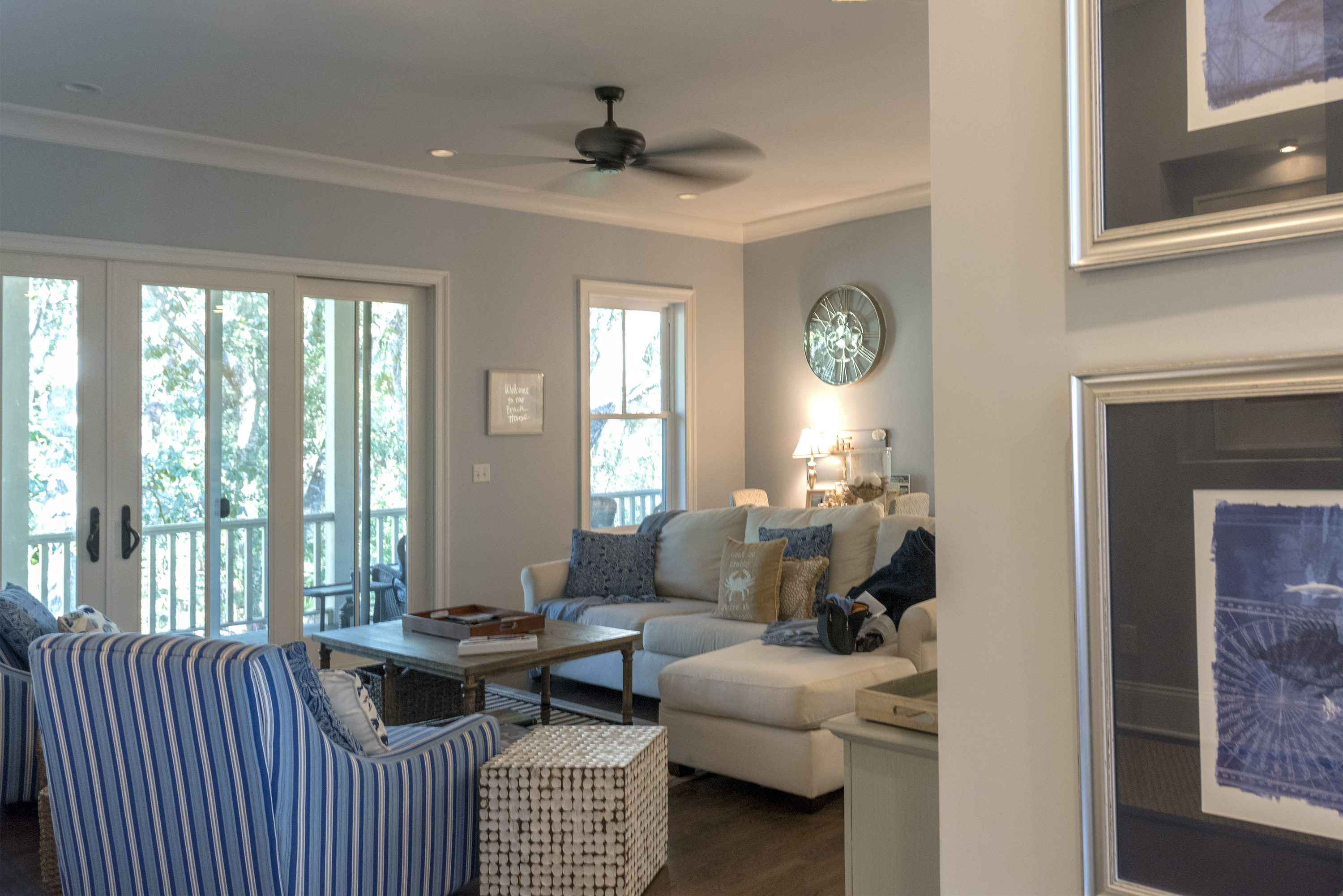 Sliding doors lead to a covered porch.