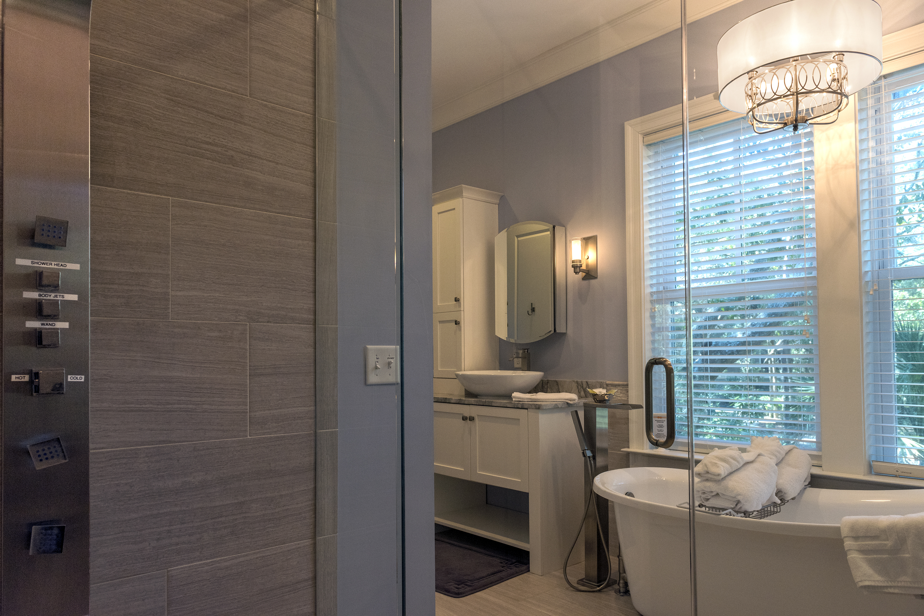 Soak in the slipper tub with a waterfall faucet under the chandelier.