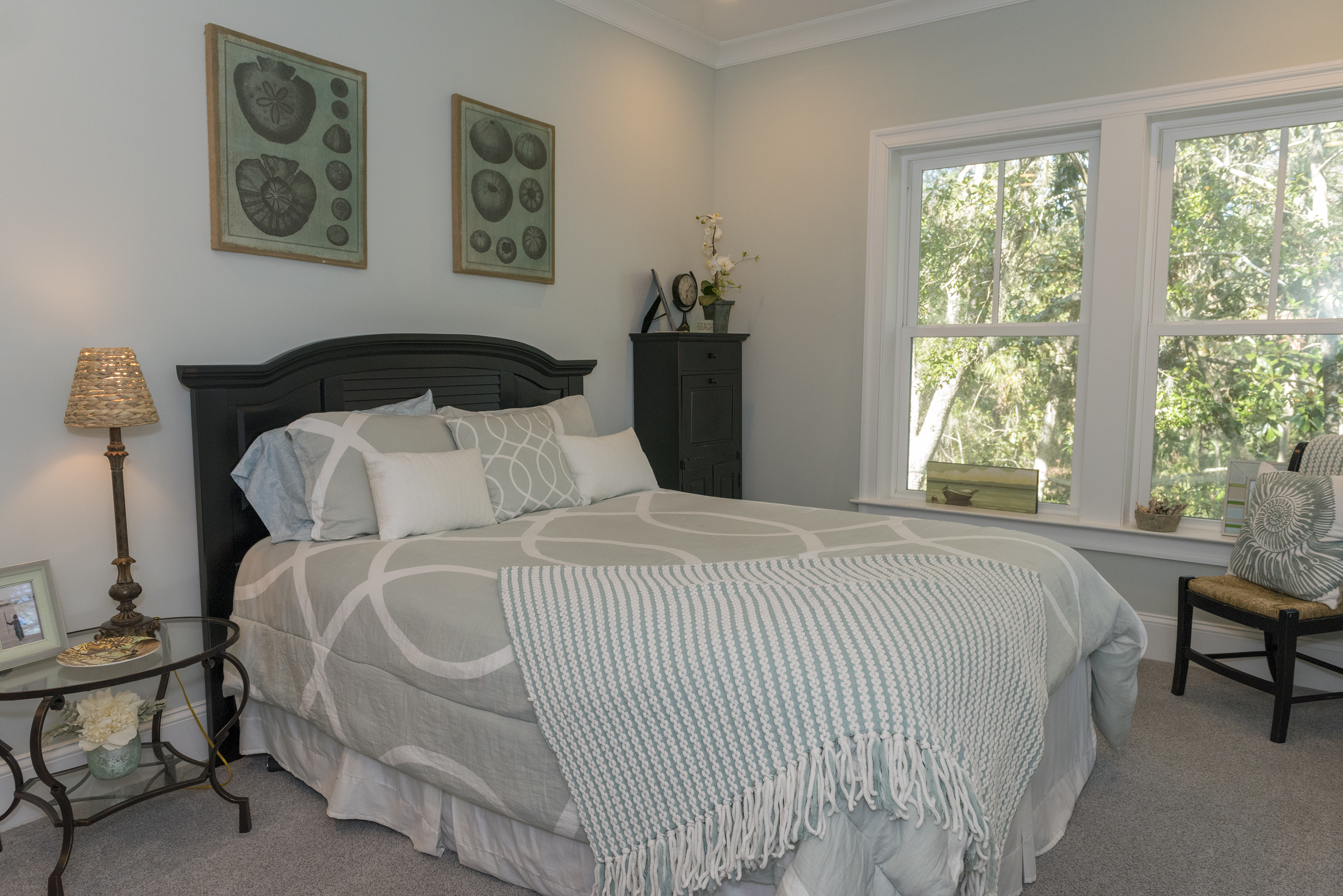 Soft grays provide a peaceful backdrop in the 4th bedroom.