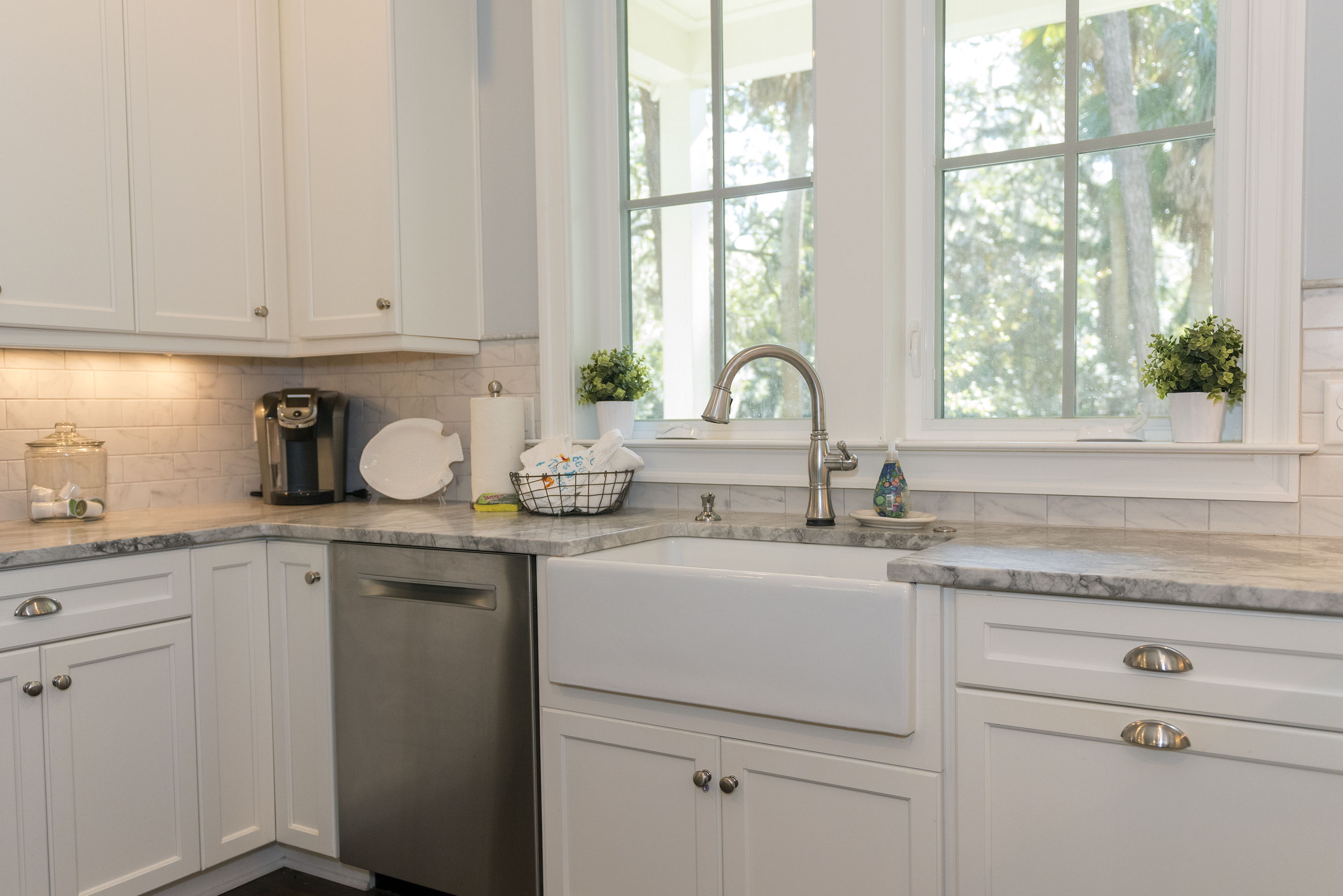 The well stocked cabinets hold all the dish ware you will need for dining.