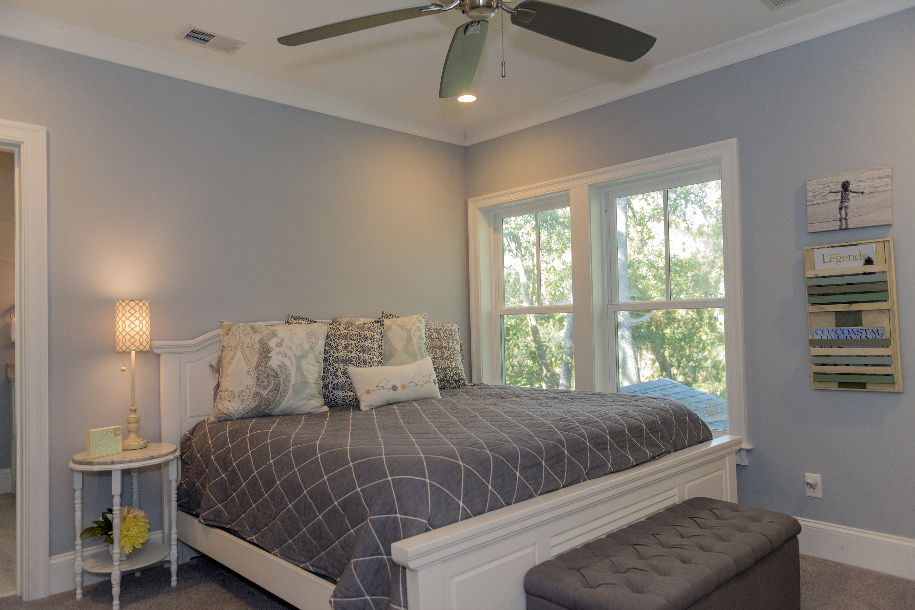 Upstairs, is a private bedroom w/ a king bed that serves as a 2nd master suite.