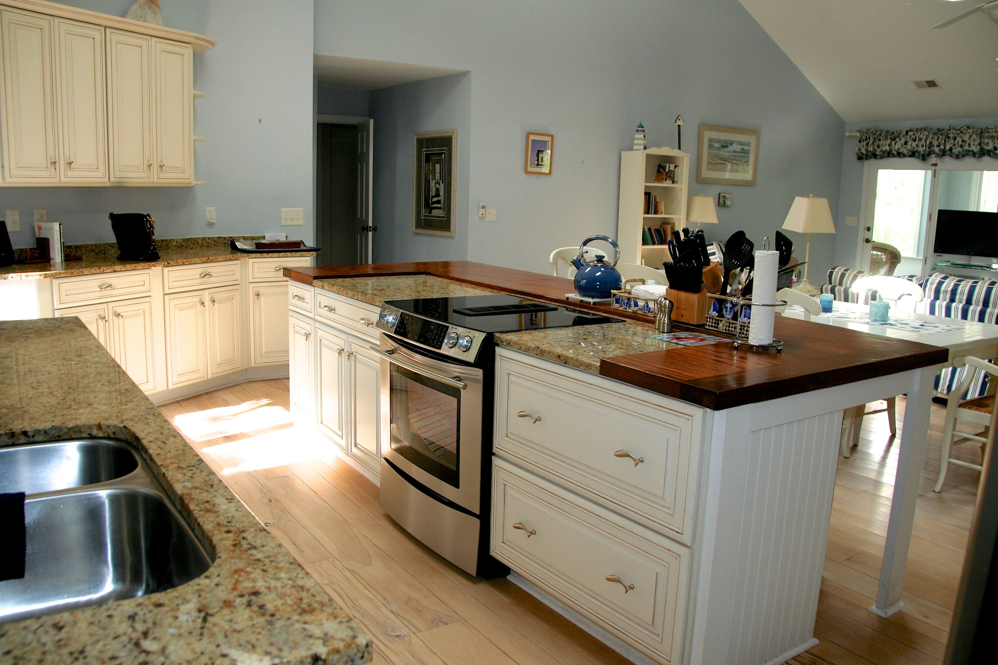 Features include stainless applicances & custom cabinetry.