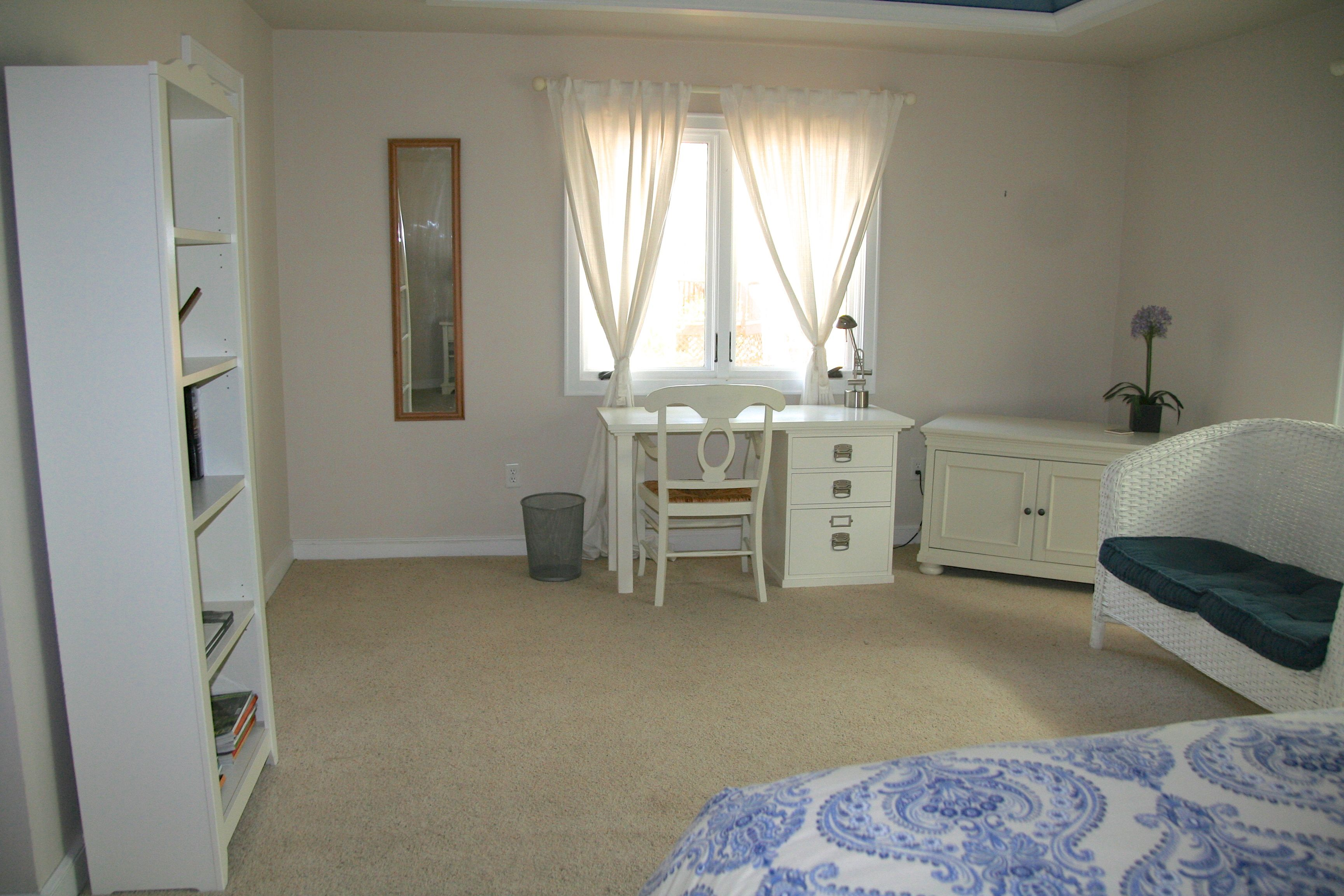 There are two walk-in closets in the master bedrom, and a desk for your computer.