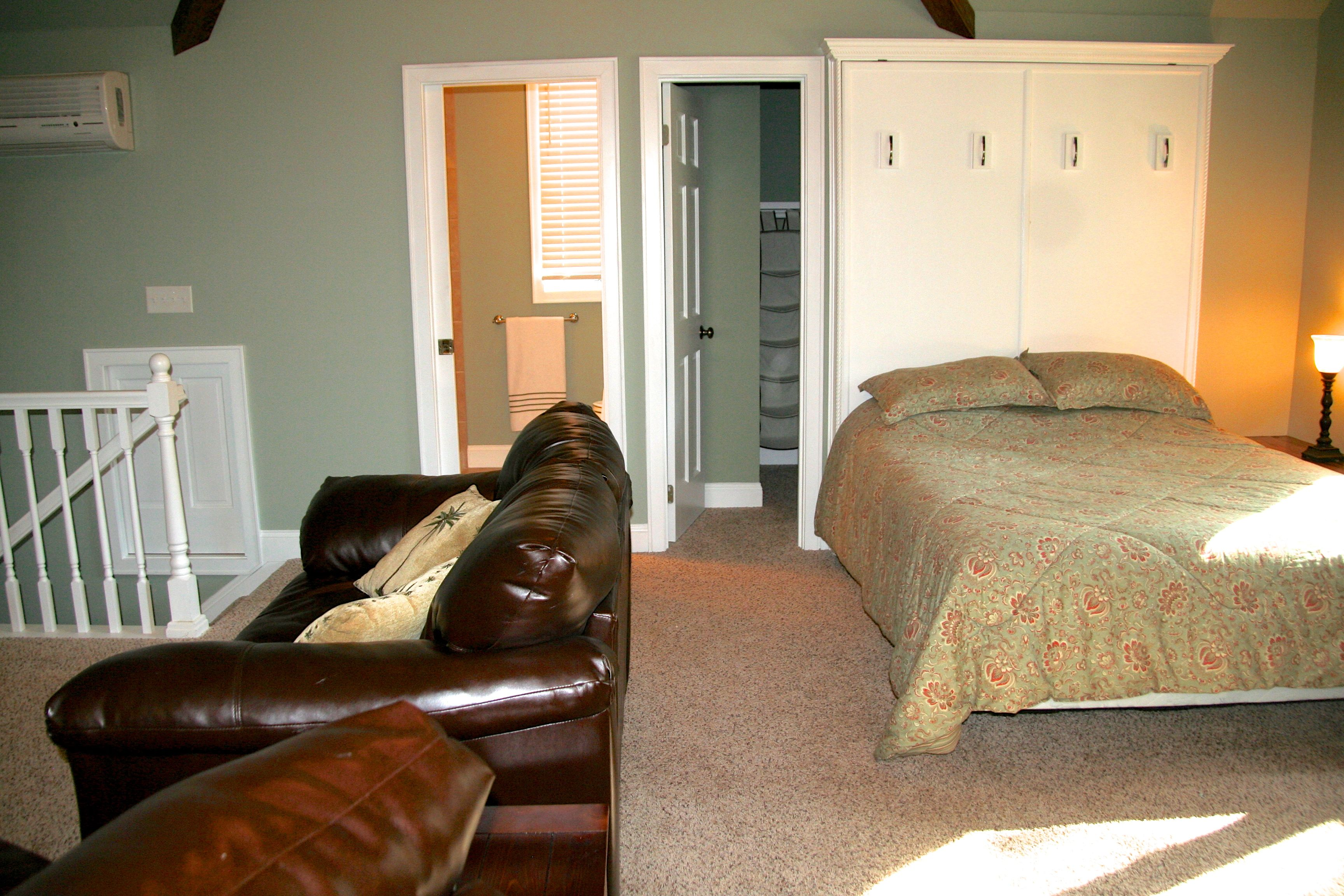 It has a wall mounted HDTV, full bath, and queen bed.