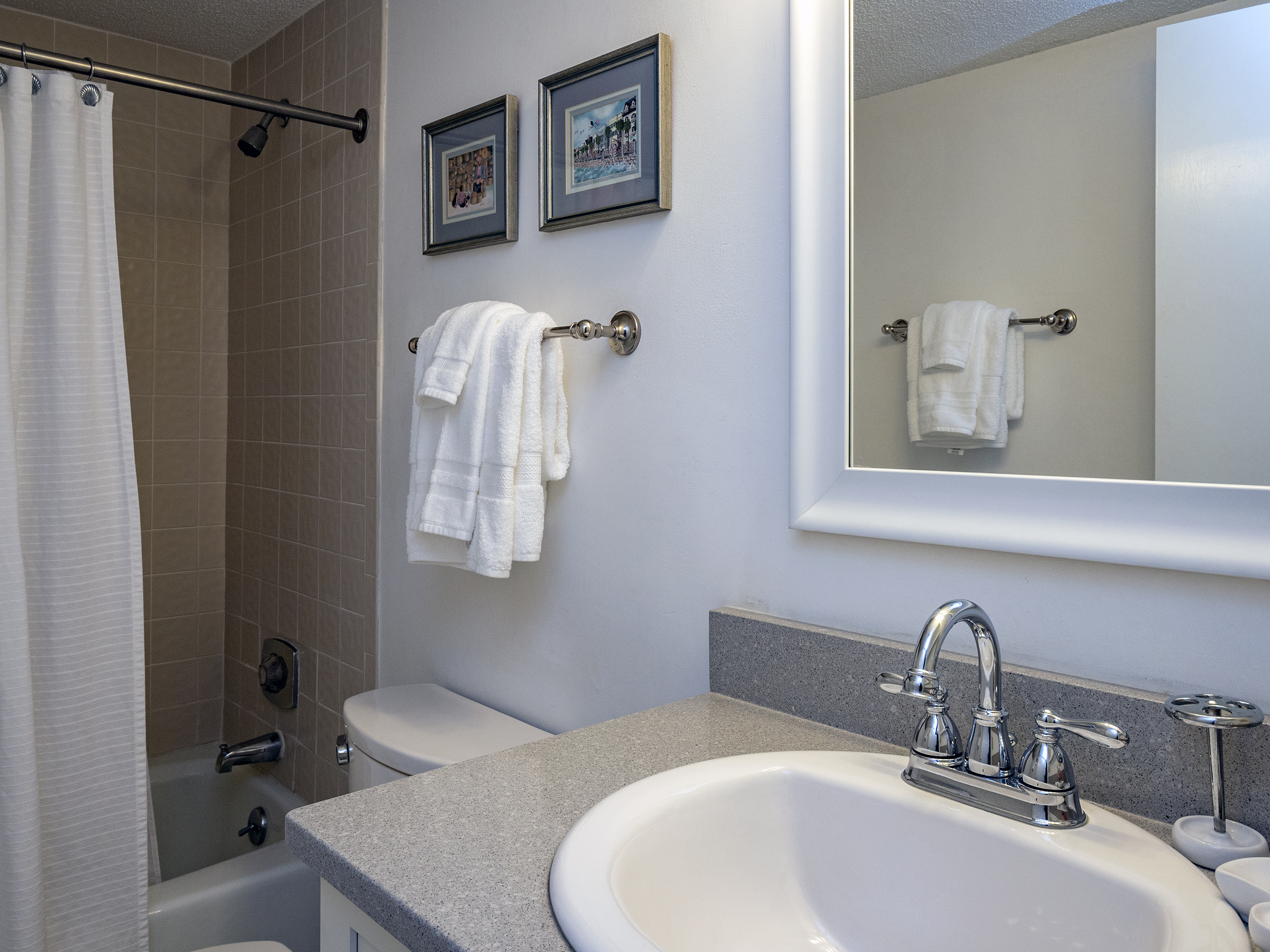 Hall access full bathroom with tub/shower combo