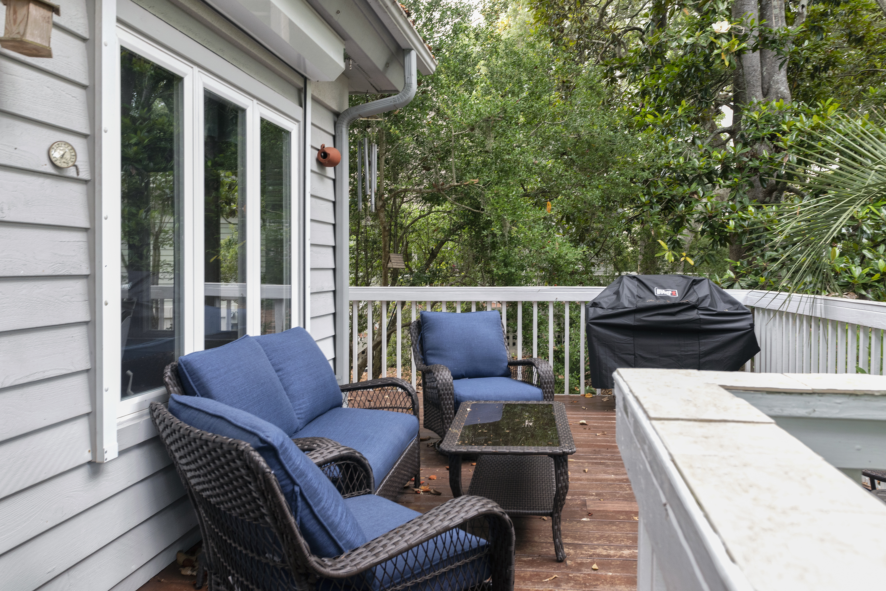 The rear deck provides a relaxing spot for evening cocktails and grilling!
