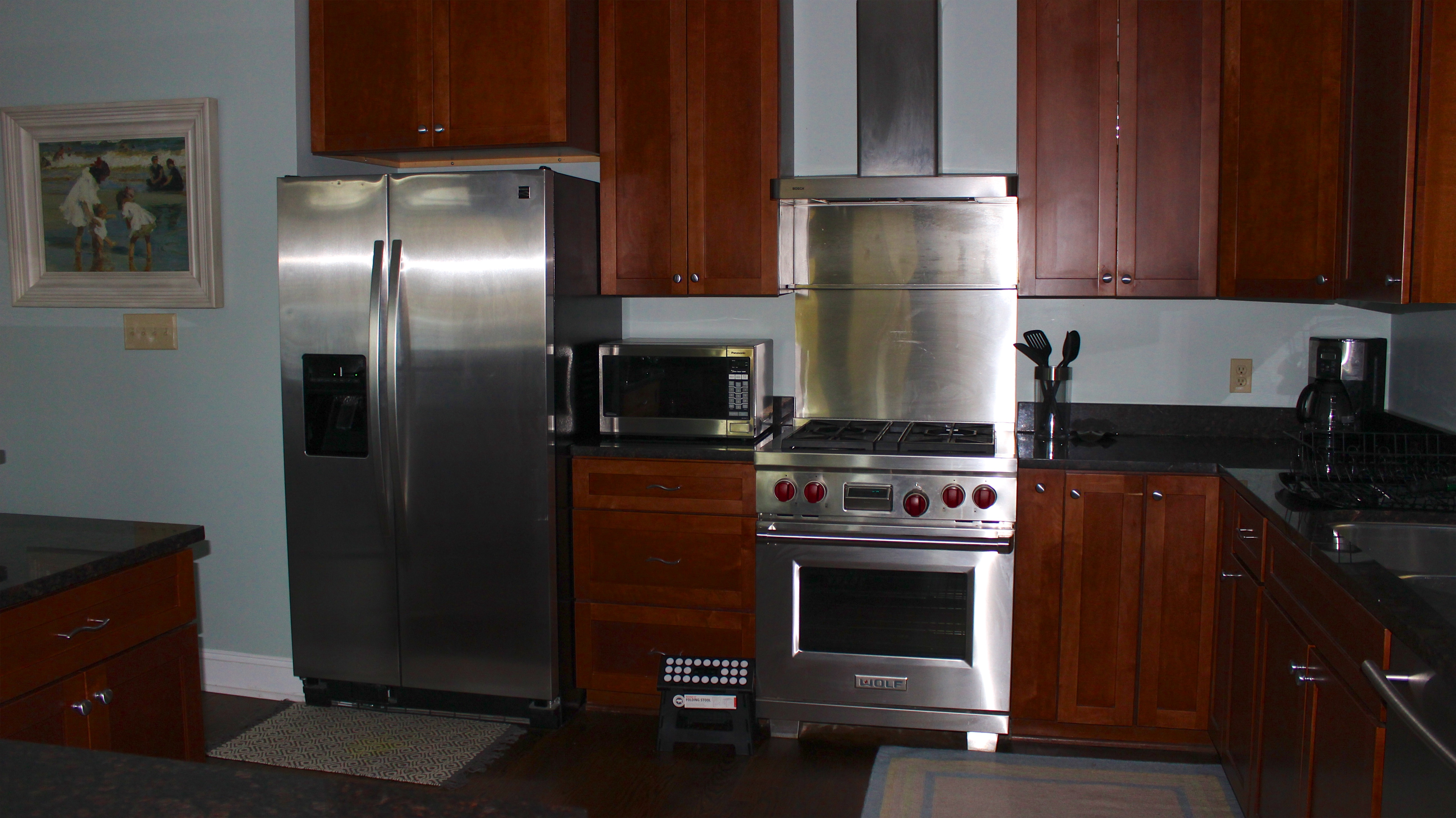 Features include stainless appliances, granite counters and a gas range/oven.