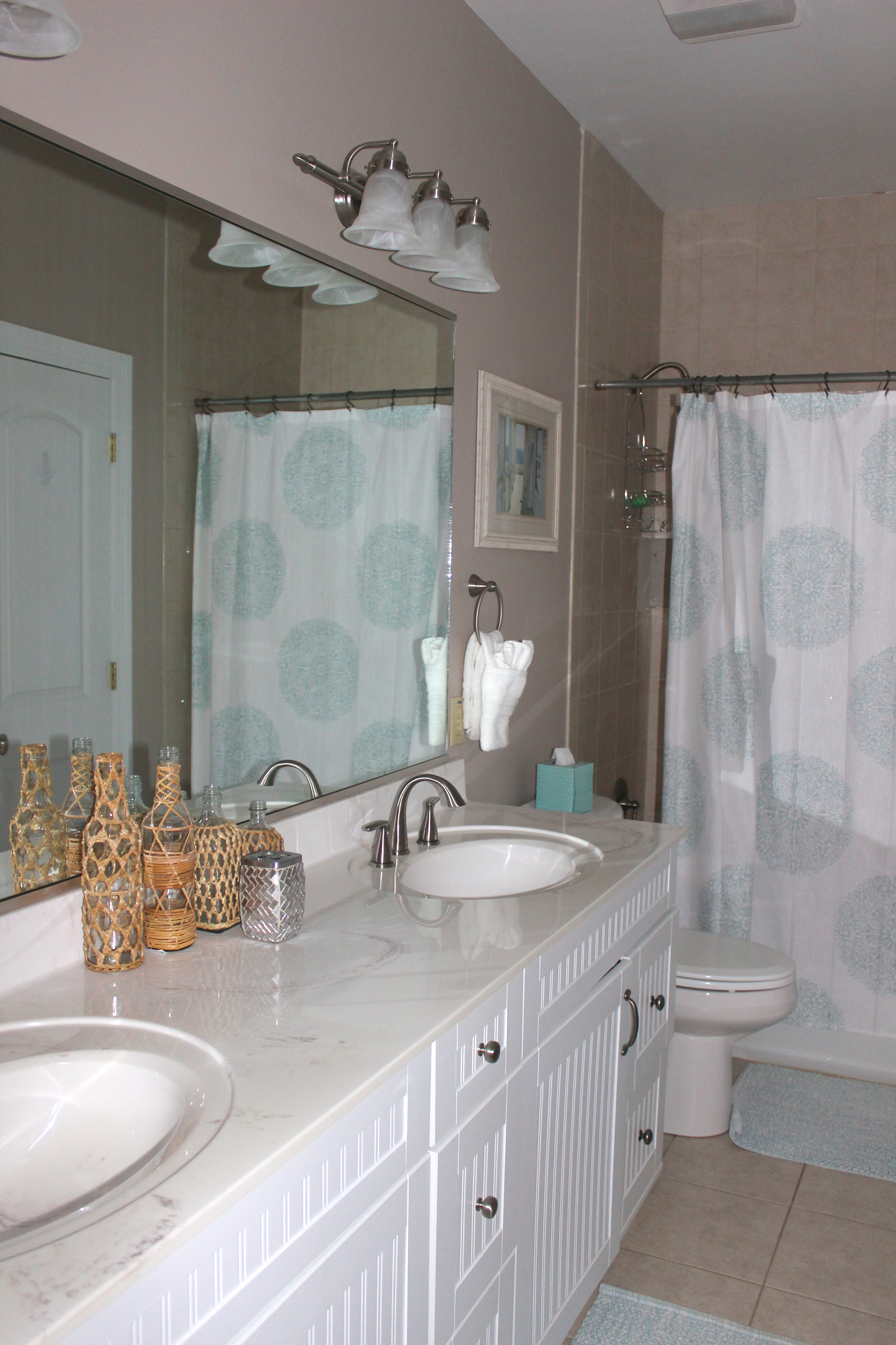 The hall bathroom has a double sink vanity and shower/tub.