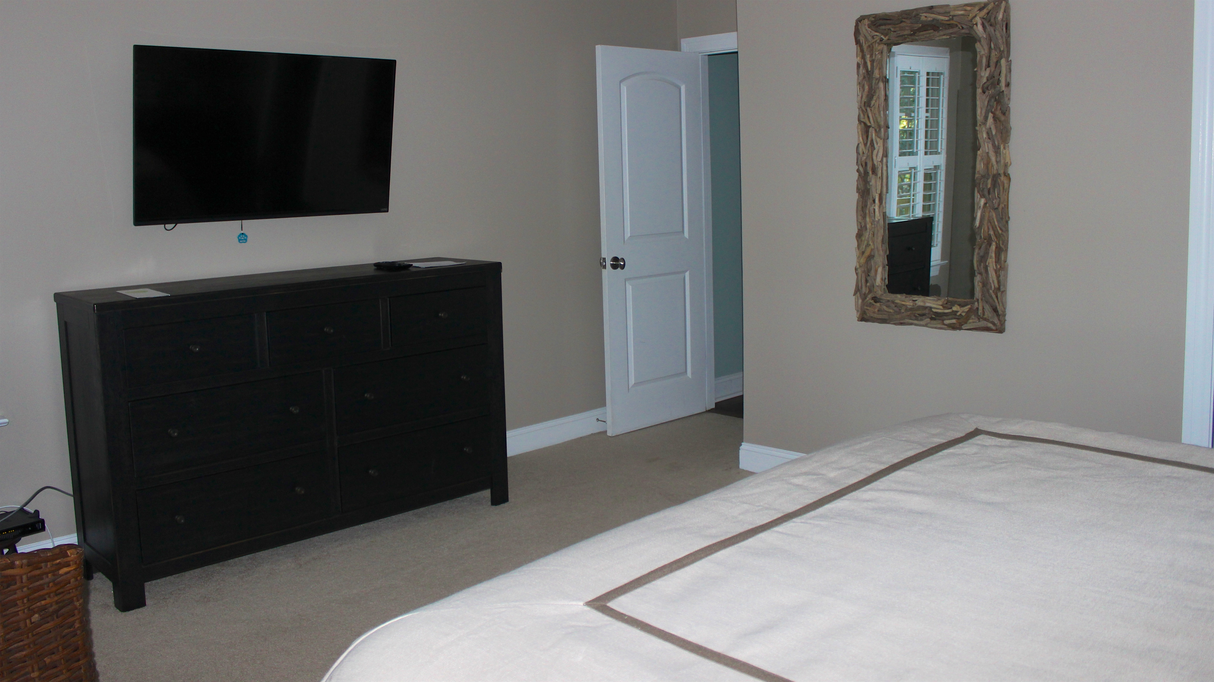 The large wall mounted HDTV is great for viewing shows.