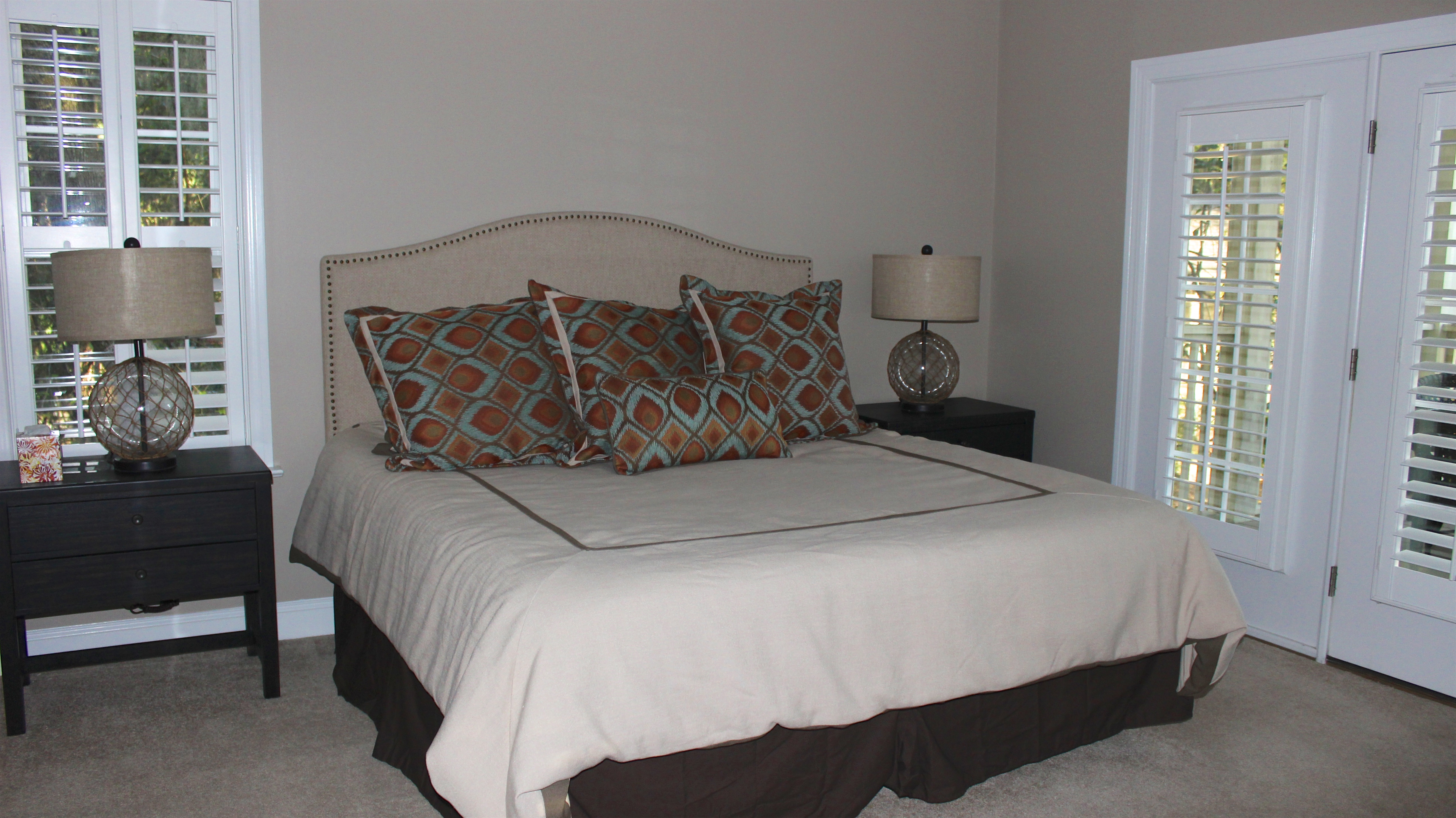 The master bedroom has a king bed and access to the screened porch.