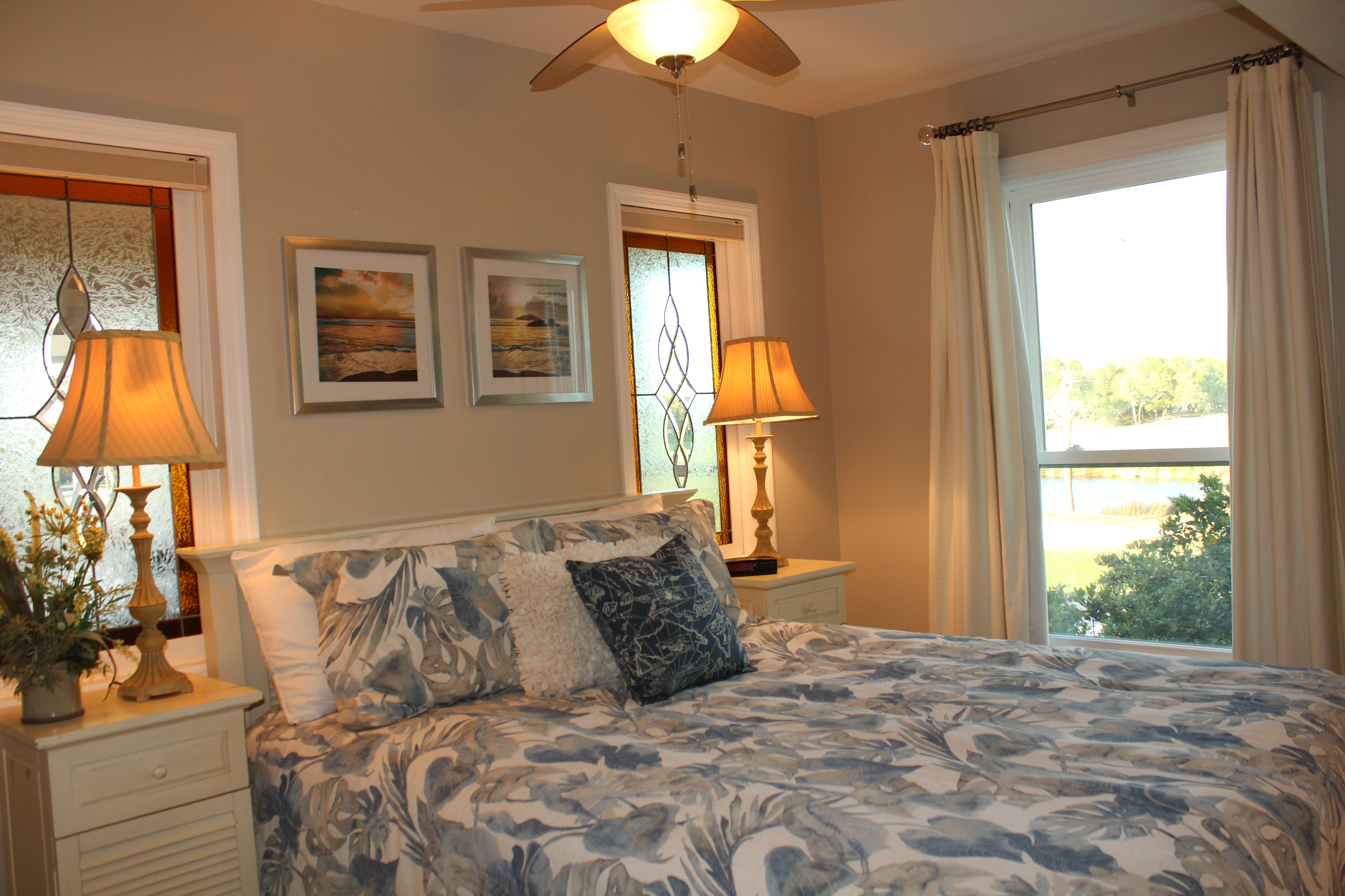 Second bedroom with queen bed, night tables (chest of drawers and TV not shown in right corner of room),Beautiful panoramic view through window.