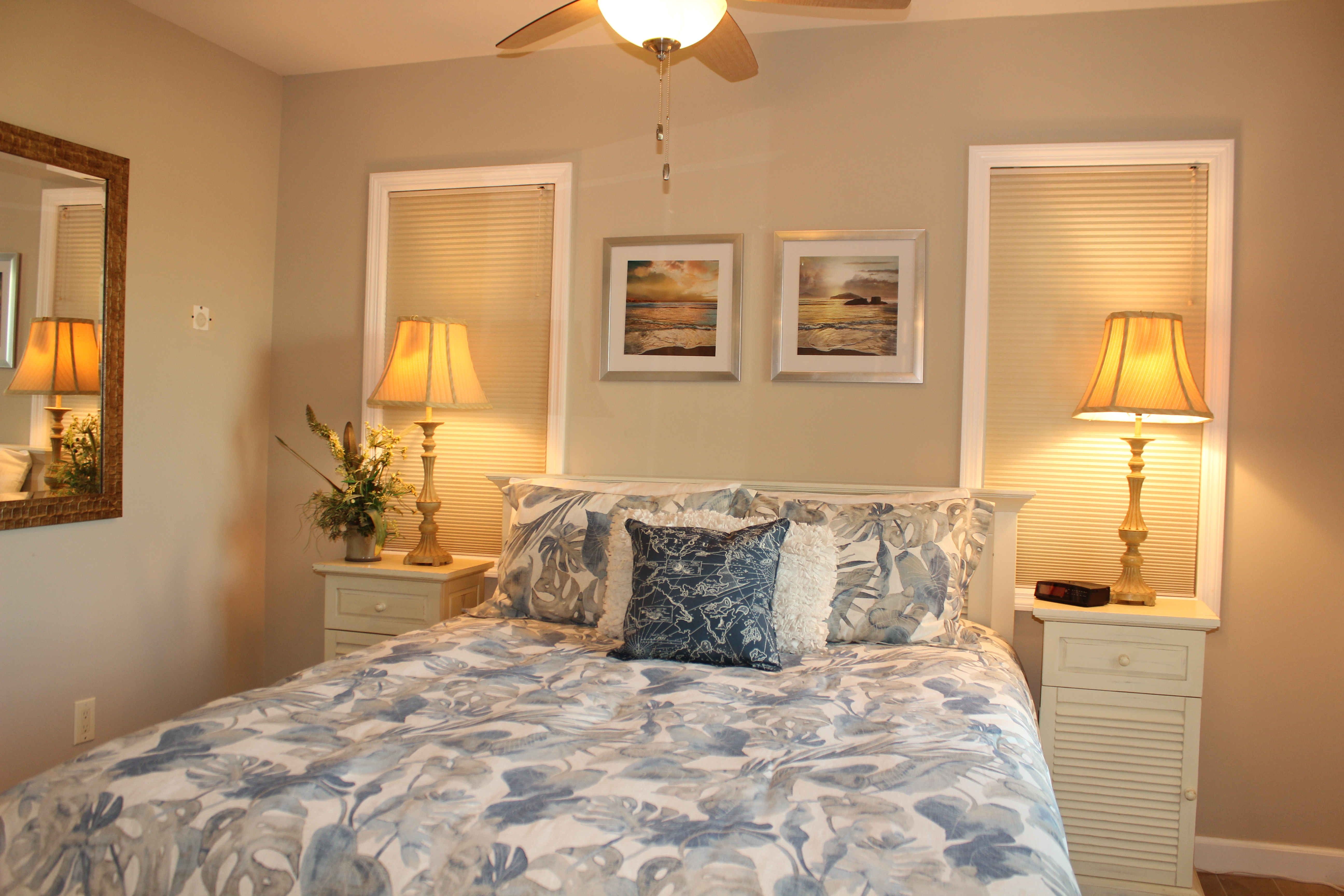 Second bedroom viewed from adjoining vanity area. Closed blinds (night time option) at internal windows.