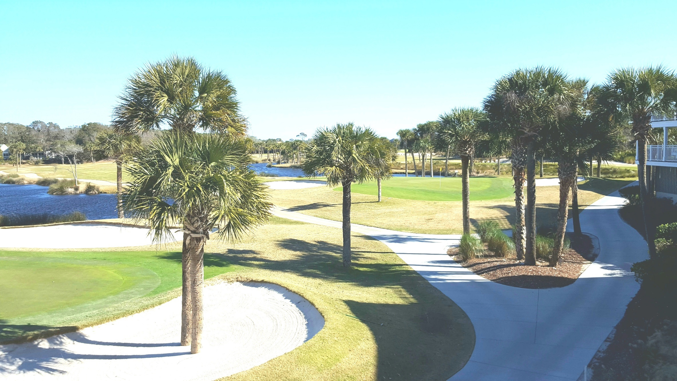 Expansive Ocean Winds golf course panorama, view east, of 18th fairway & green. 10th fairway in the distance.