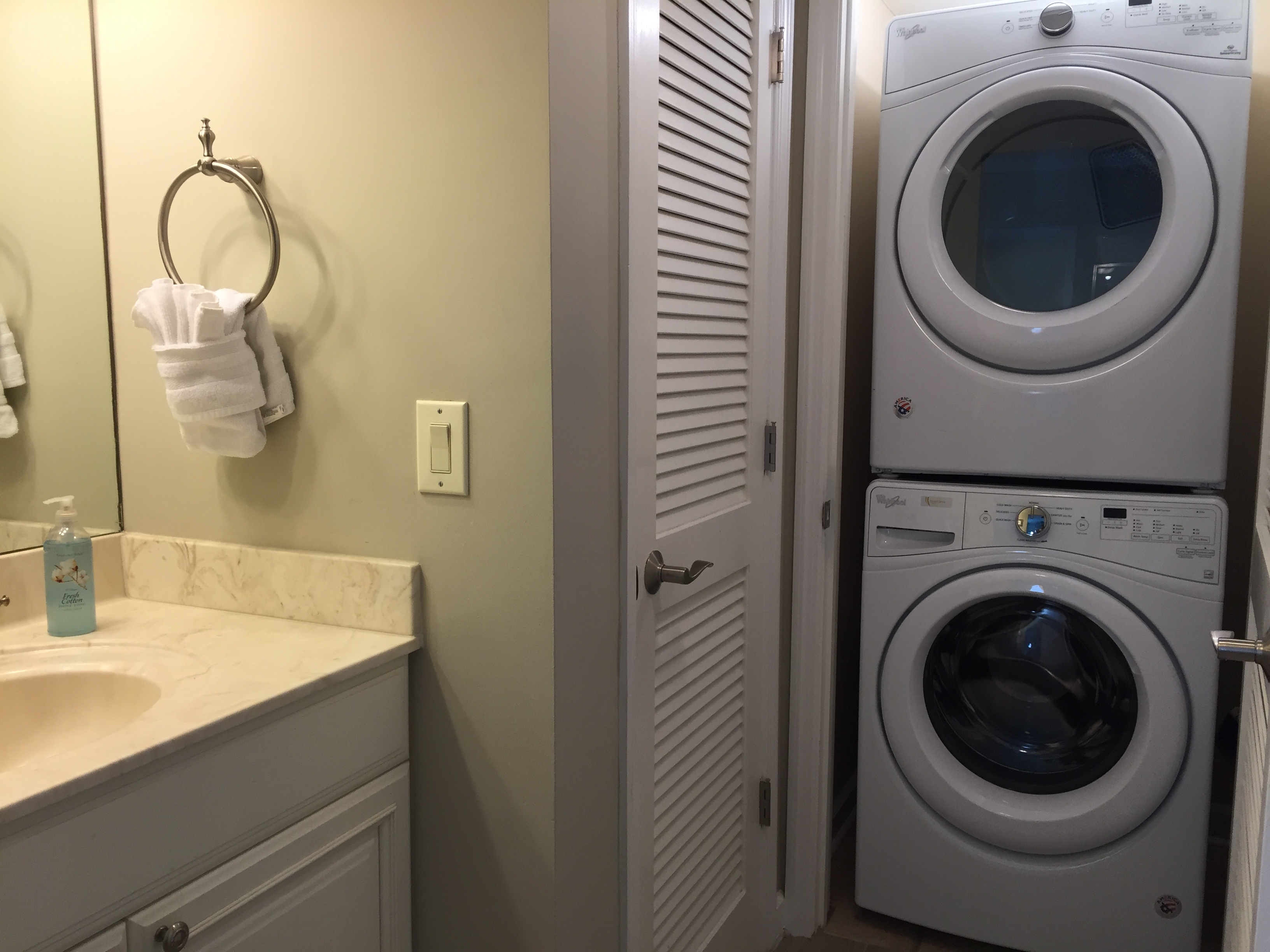 Laundry with stacked Washer & Dryer
