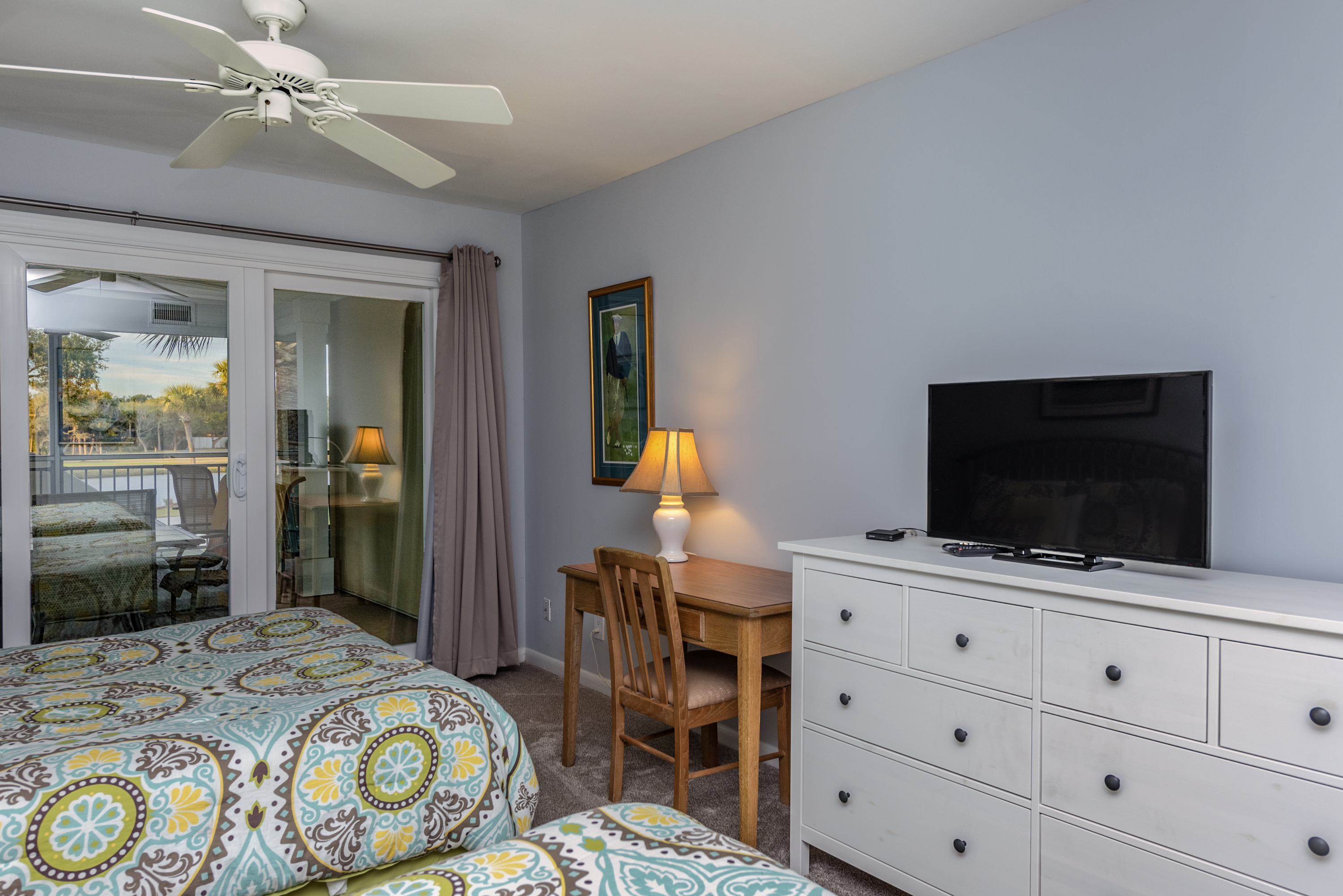 The second bedroom also has two queen beds. There is a desk for your computer and an HDTV too.