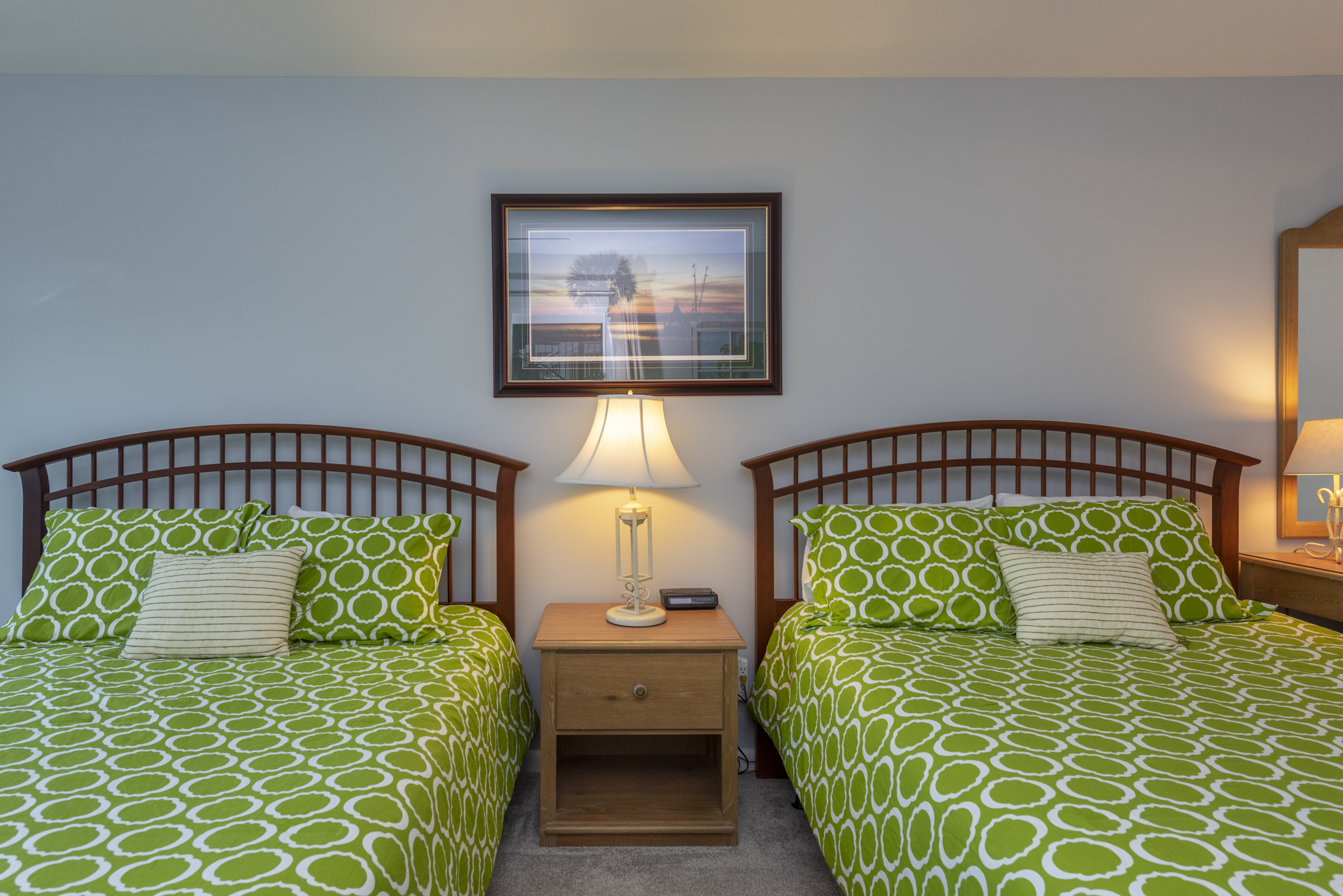 It has two queen beds and sliders leading to the covered patio.