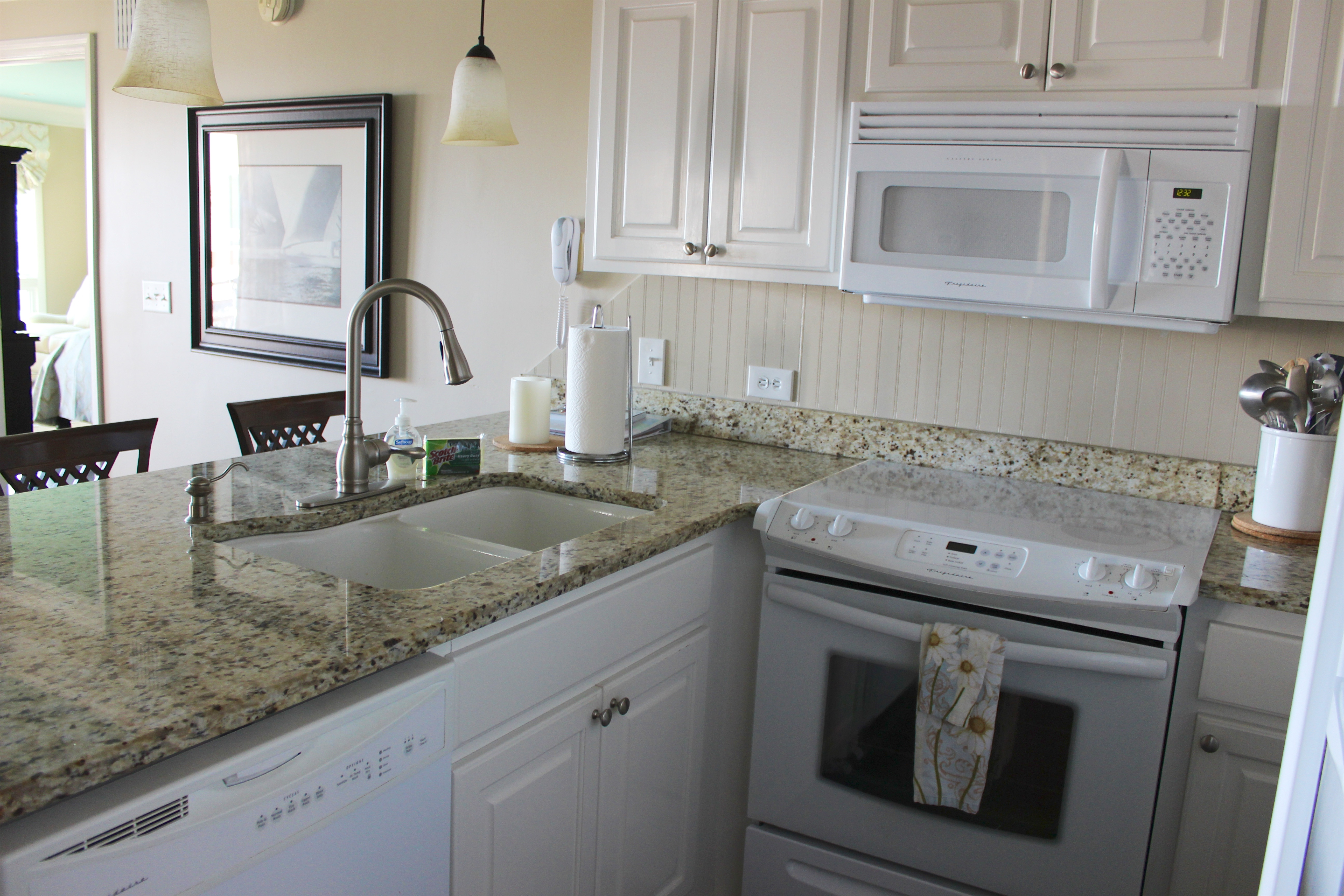 The kitchen features granite counters and has been beautifully updated.