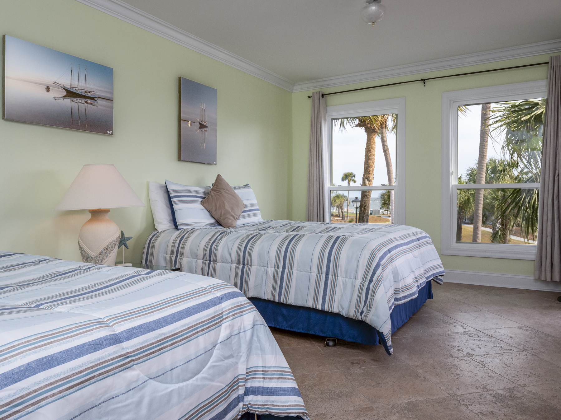 2 Queen beds complete the 2nd bedroom with HDTV and sliding glass doors to the covered deck.