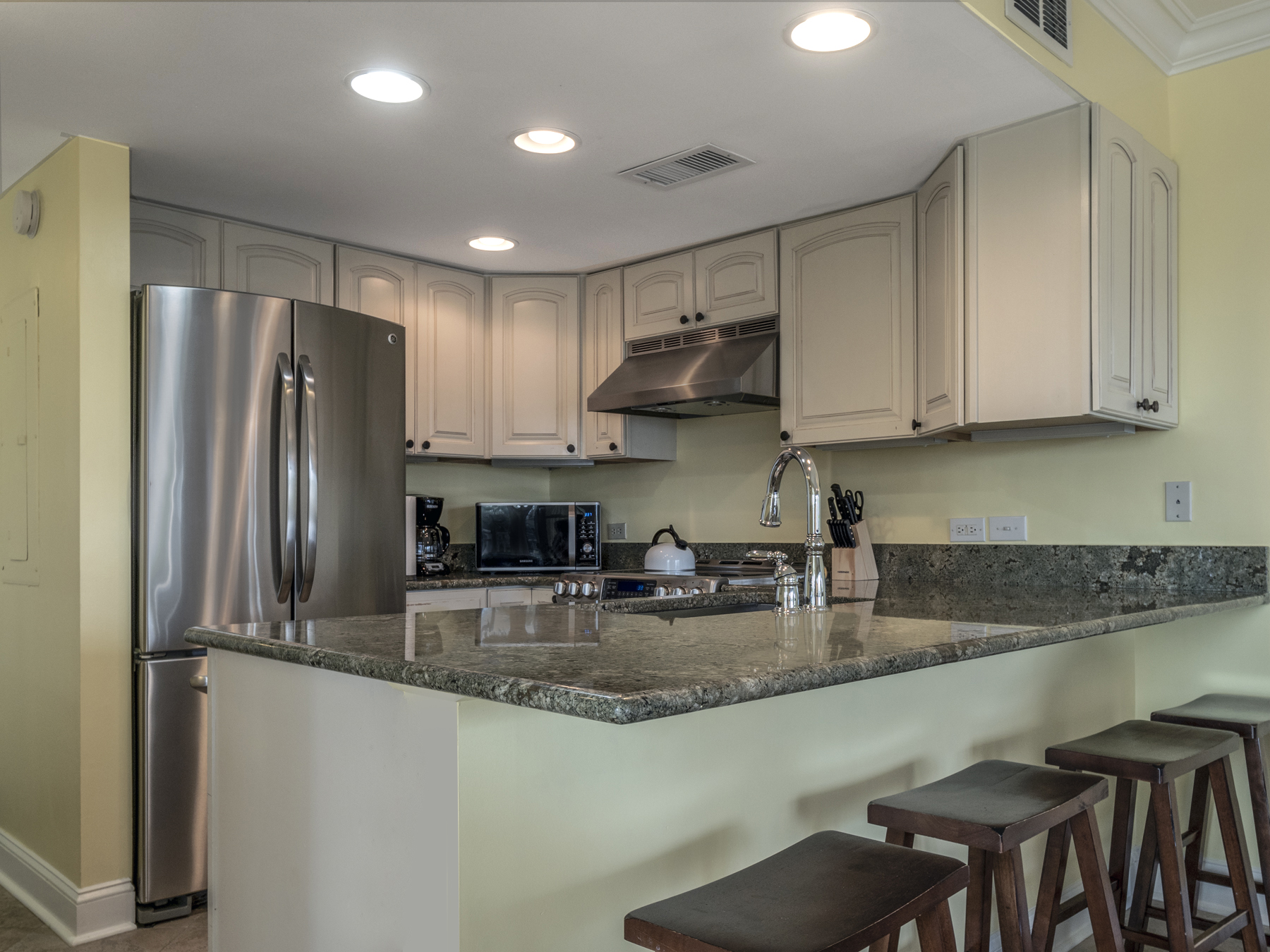 Kitchen with granite counter tops, stainless steel appliances!  Counter seating for four.